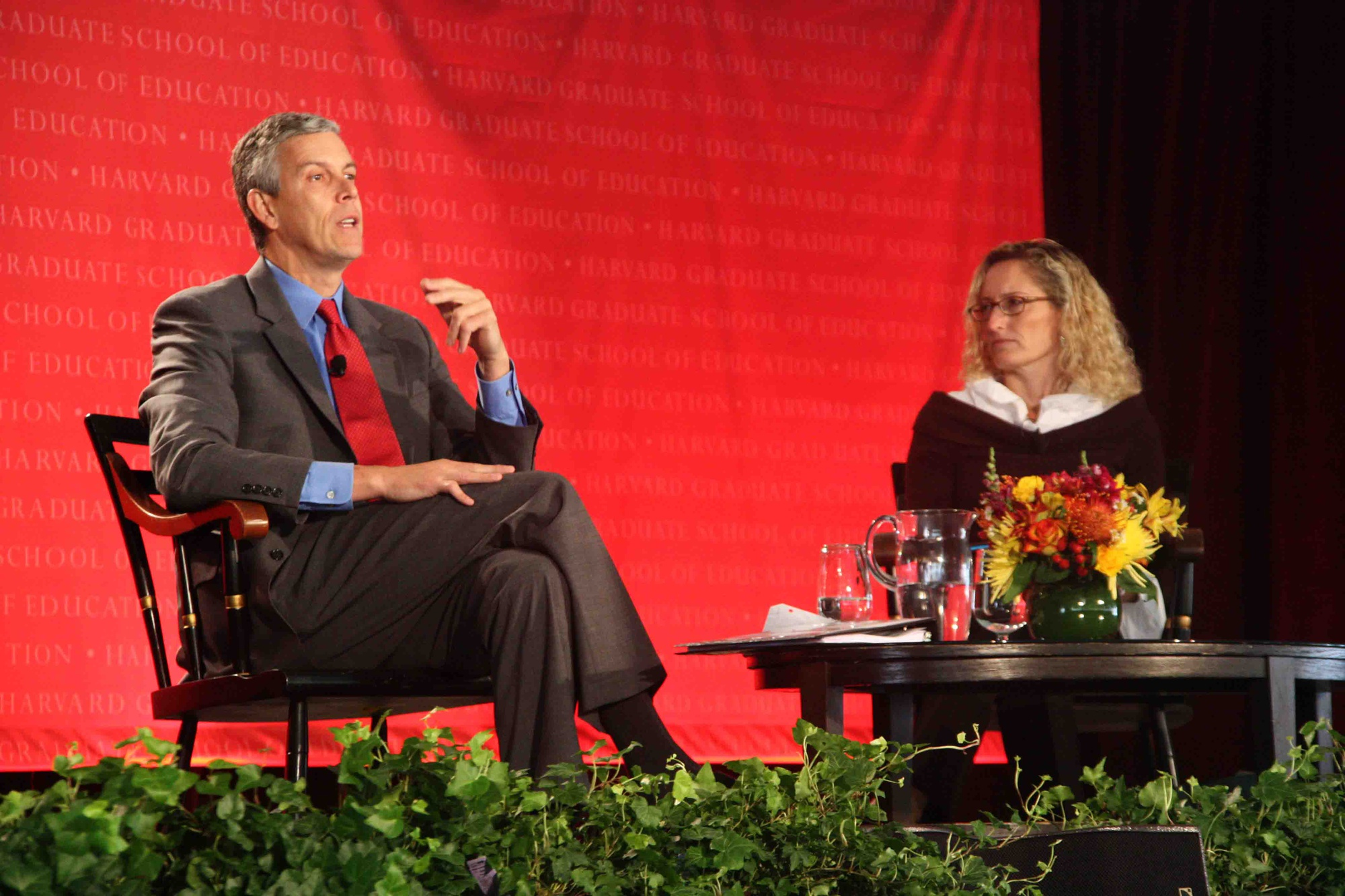 U.S. Secretary of Education Arne S. Duncan '86 speaks with professor Monica Higgins about the Common Core testing standards during the Graduate School of Education's capital campaign launch Friday.