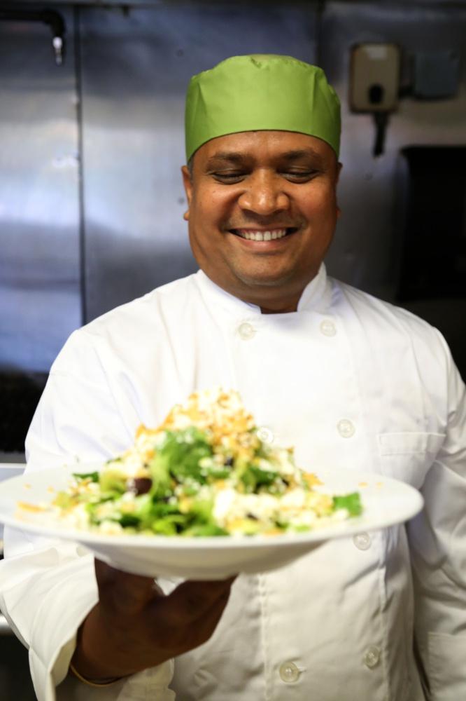 Pankaj Pradhan reveals a dish at his restaurant The Red Lentil in Belmont. Pradhan designed HUDS' new vegetarian offerings this year.