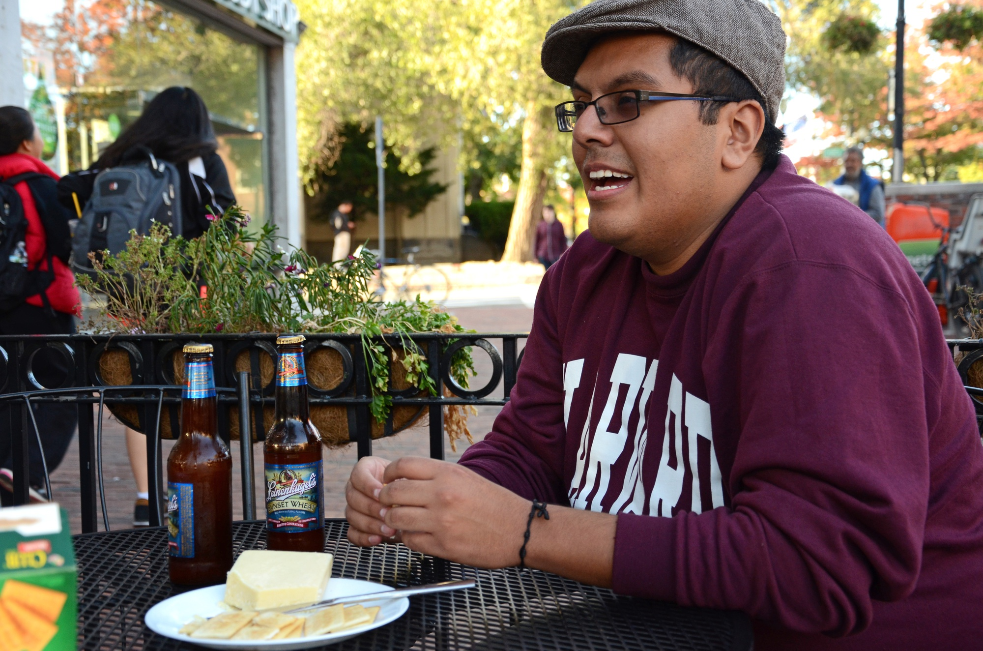 Fernando R. Espino '15, president of the Wisconsin club, discusses Wisconsin traditions and Packer pride over Leinenkugel-brewed beer and cheddar cheese.