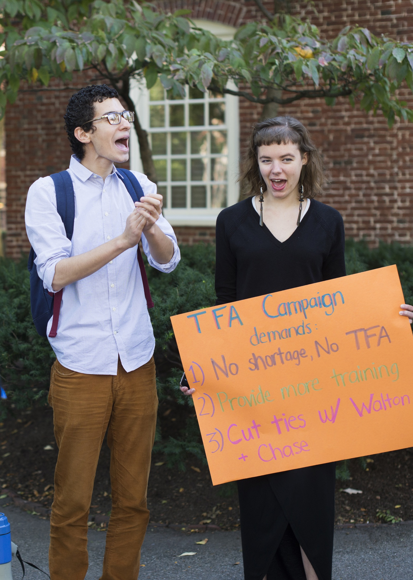 "Chanting ""education not privatization,"" Gabriel H. Bayard '15 and Hannah L. McShea '18 protest Teach For America on Friday, Sept. 26 outside Massachusetts Hall."