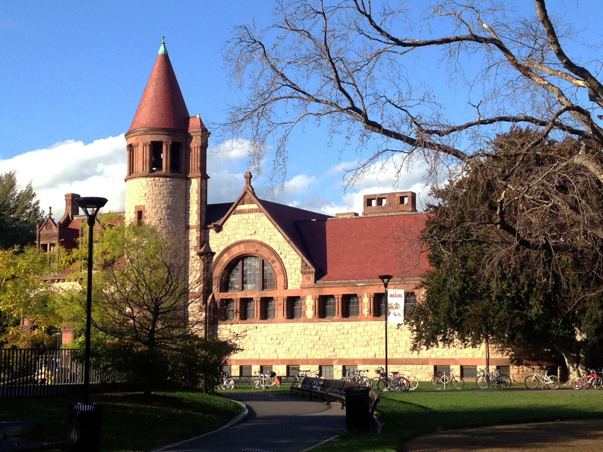 Distinctly known for its reddish stone exterior ad ts turret, the historic building of the Cambridge Public Library was built in 1888.