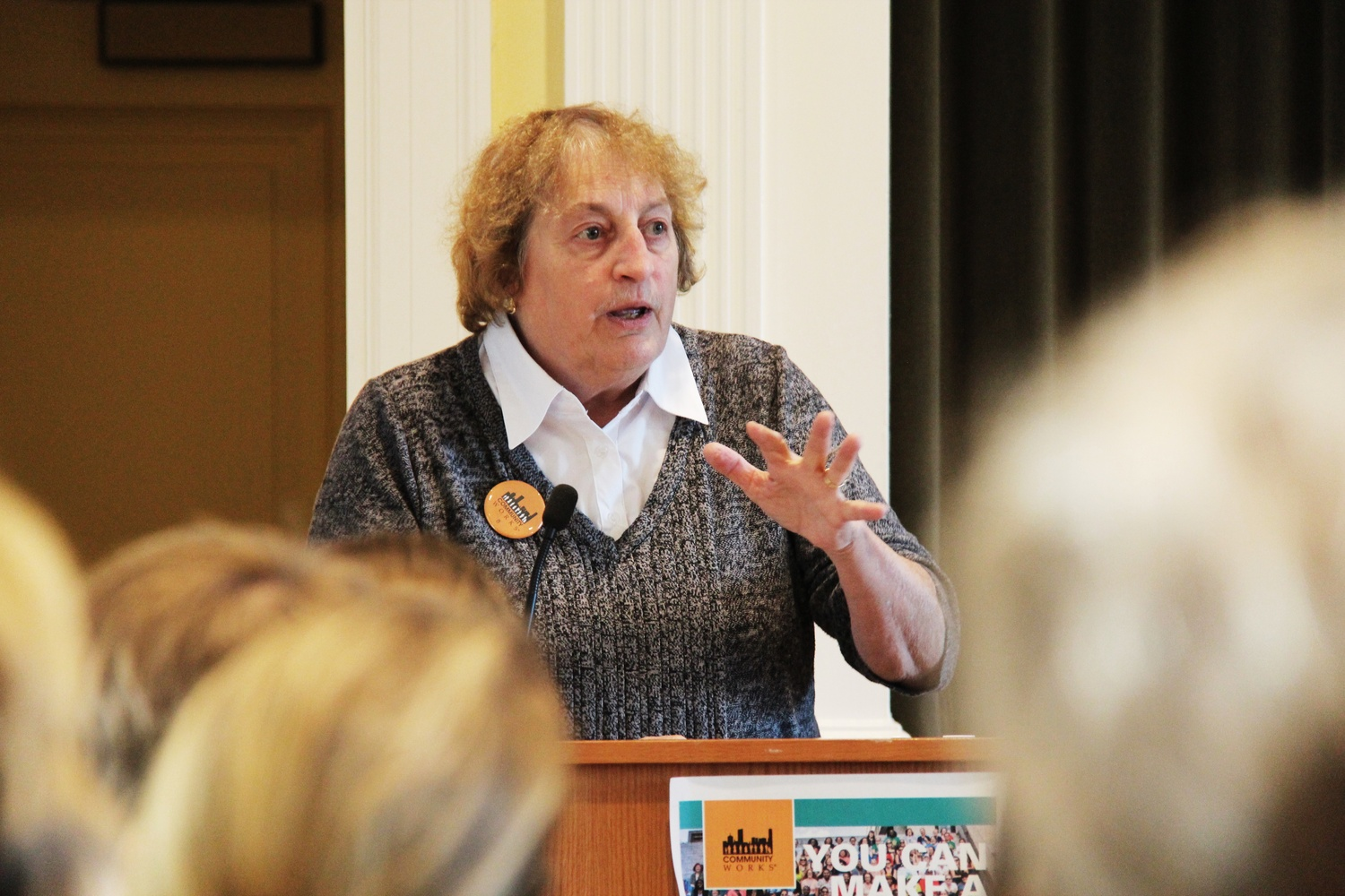 "Fran Froelish from Community Works introduces the Carol Rose, the speaker, for the ""In Defense of Women"" talk at the Fay House on Monday afternoon."