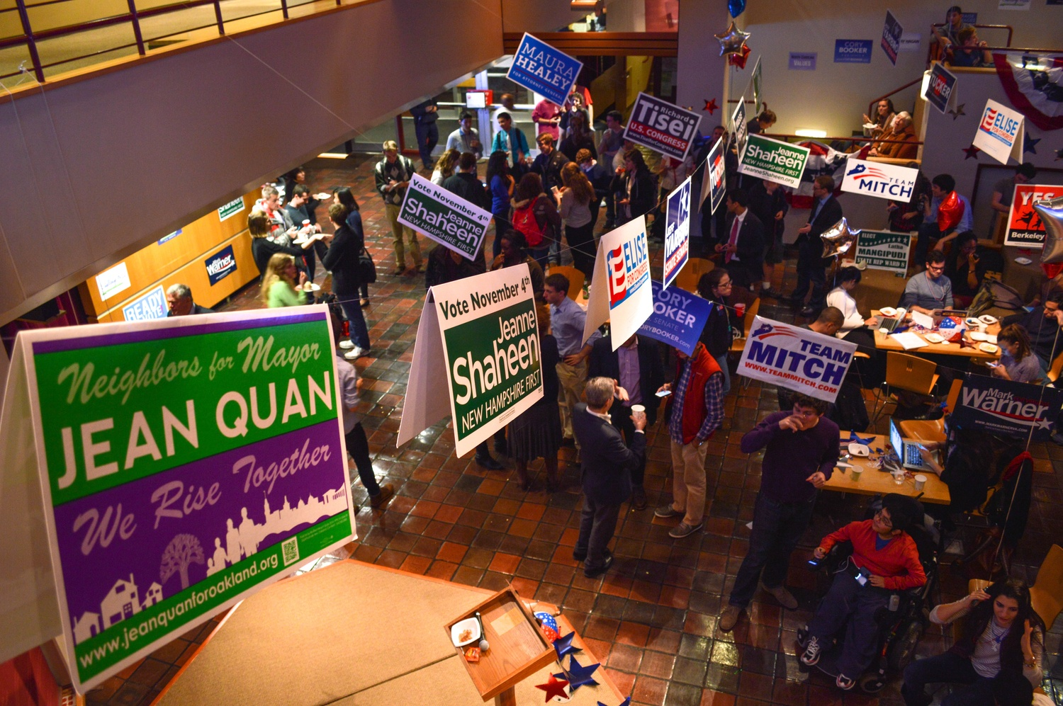 Under campaign banners and helium balloons, students and non-students alike congregate at the Institute of Politics in anticipation of the 2014 election results.