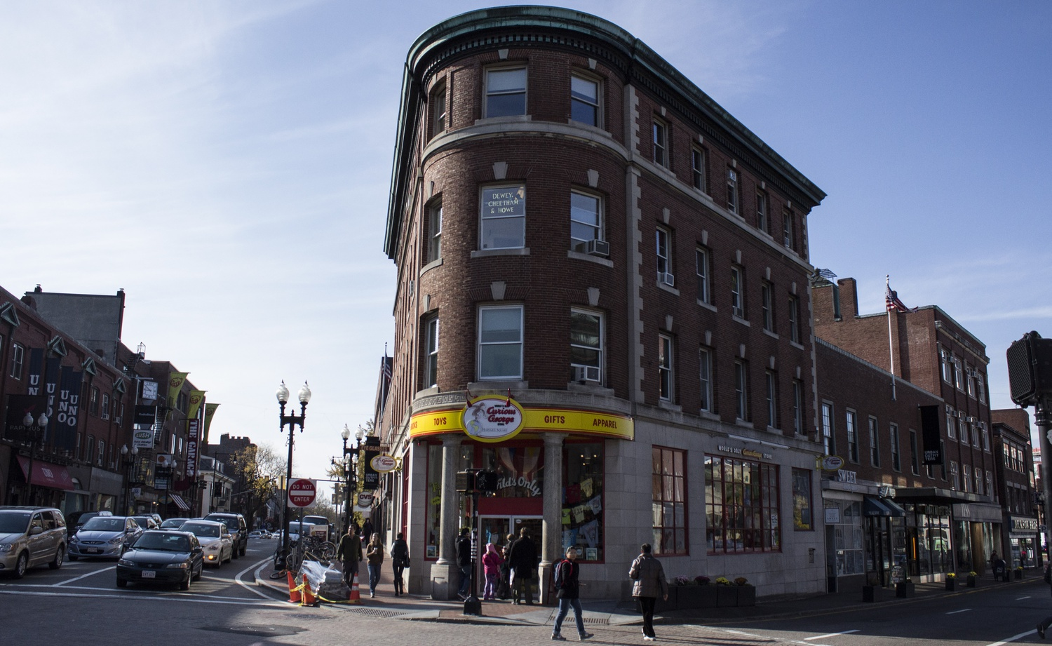 The fictional firm Dewey, Cheetham, & Howe is located above the Curious George store on the corner of JFK and Brattle Streets.
