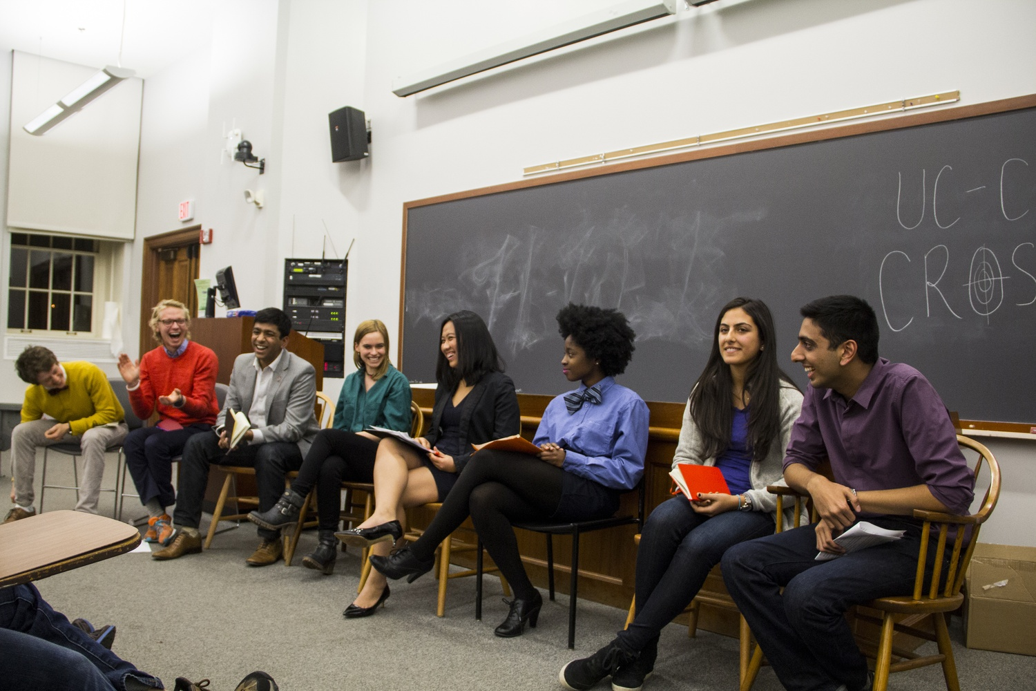 At right, Ava Nasrollahzadeh '16 and Dhruv P. Goyal '16—now Undergraduate Council president and vice president, respectively—discuss platforms with other candidates at a debate in November 2014.