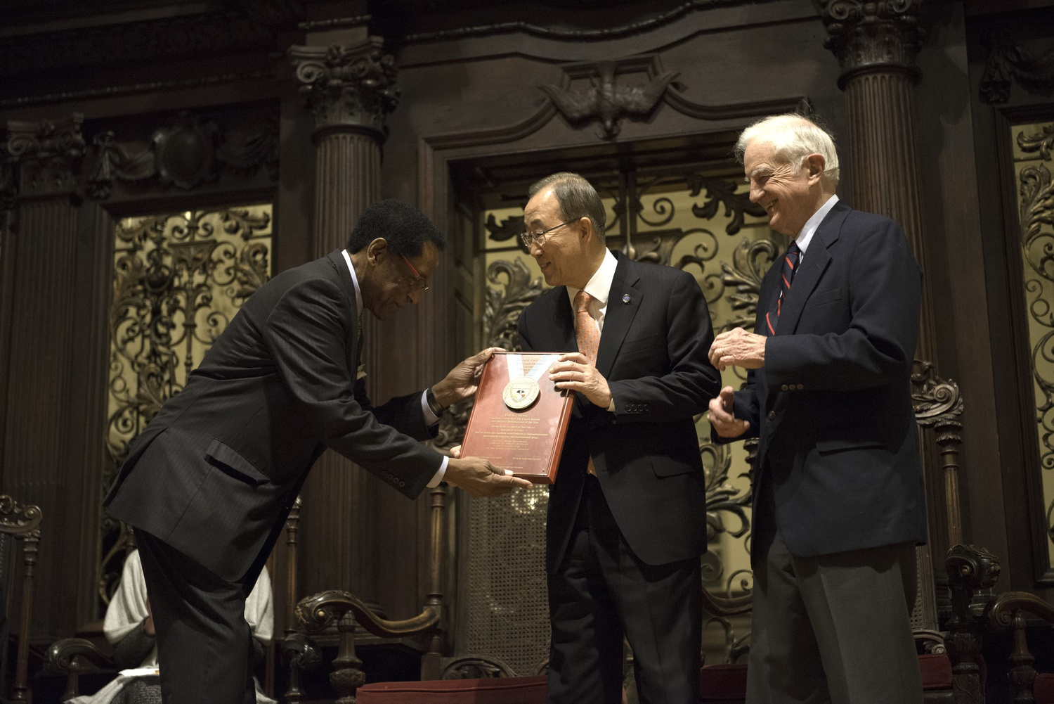 Ban Ki Moon accepts the Harvard Foundation Peter J. Gomes Humanitarian Award as the 2014 Humanitarian of the Year on Tuesday in Memorial Church. Dr. S. Allen Counter Jr., the Director of the Harvard Foundation, and Derek C. Bok presented the award.
