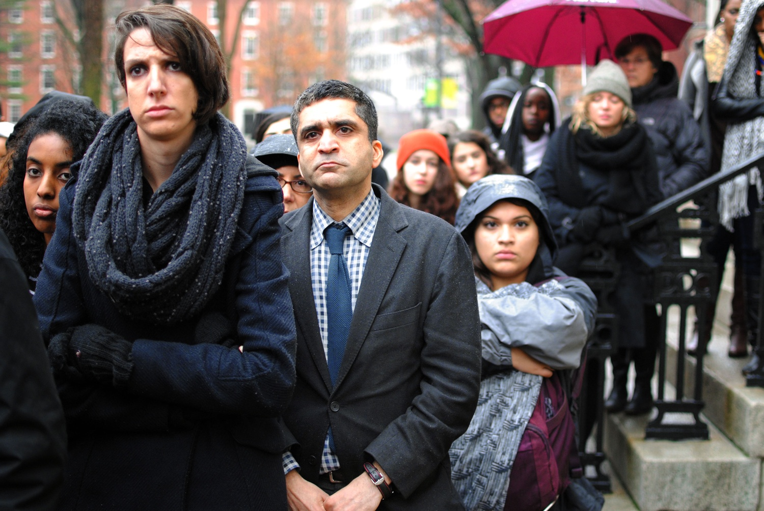 Dean of Harvard College Rakesh Khurana stands among members of the Harvard community at a protest in December outside University Hall in 2014.