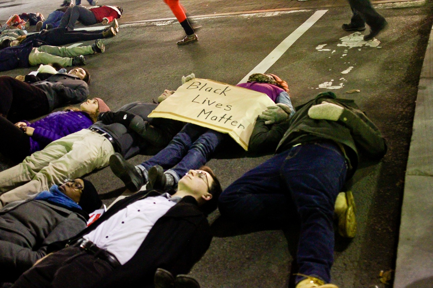 A protestor at the die-in in Harvard Square on Friday evening.