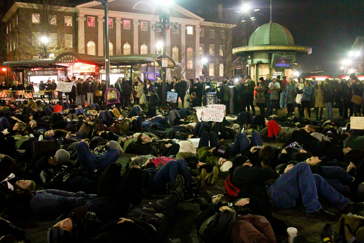 Protestors at the die-in in Harvard Square on Friday evening.