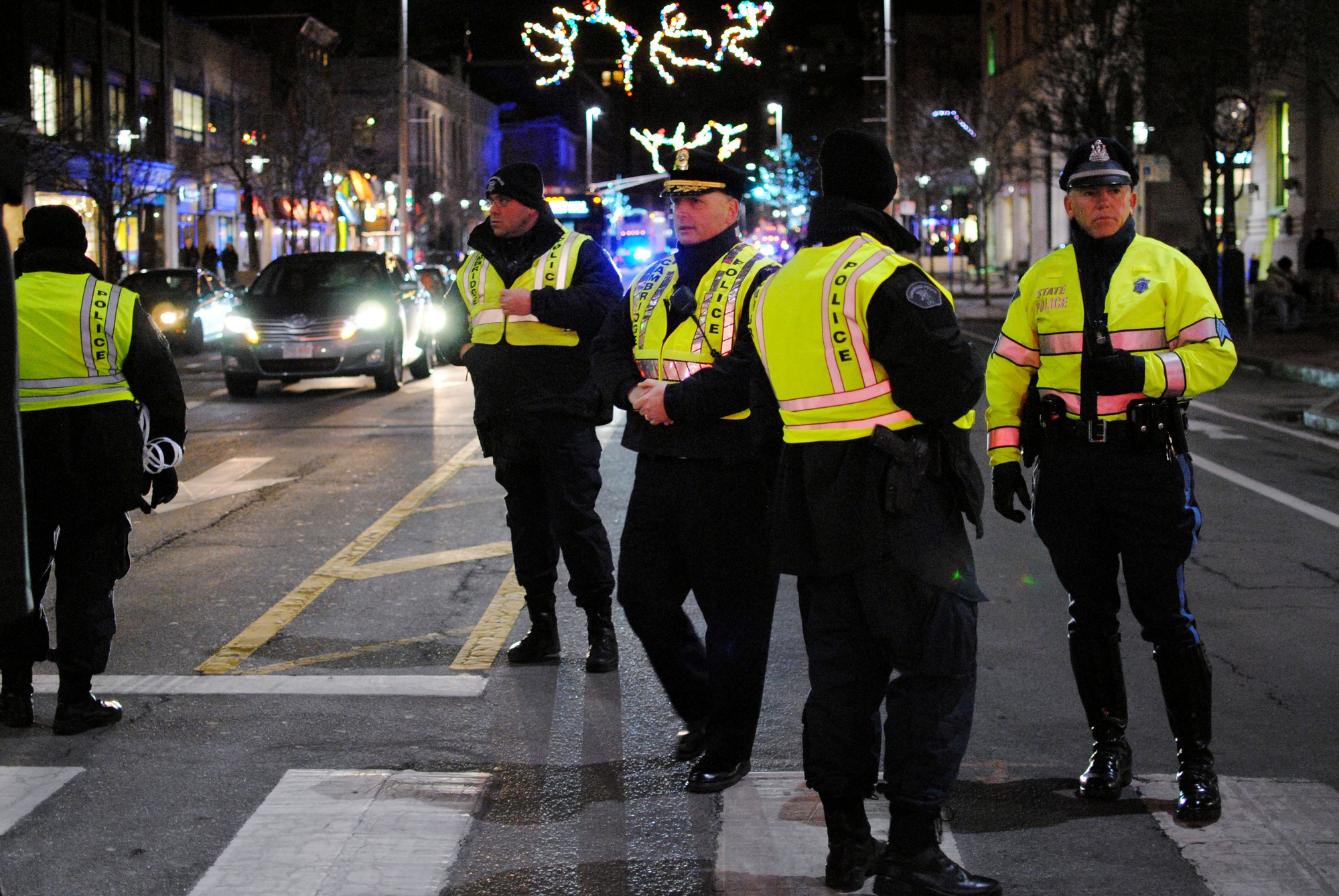 Cambridge police officers block traffic on Mass. Ave. as Harvard protesters stage a die-in in December in Central Square.