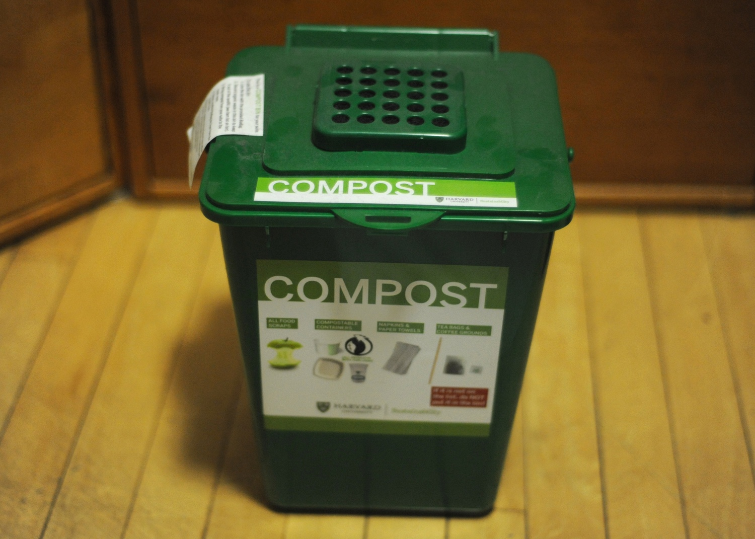 A compost bin sits on the floor of a freshman dorm room Friday night. These compost bins were placed in freshman dorm rooms to encourage composting and sustainability.