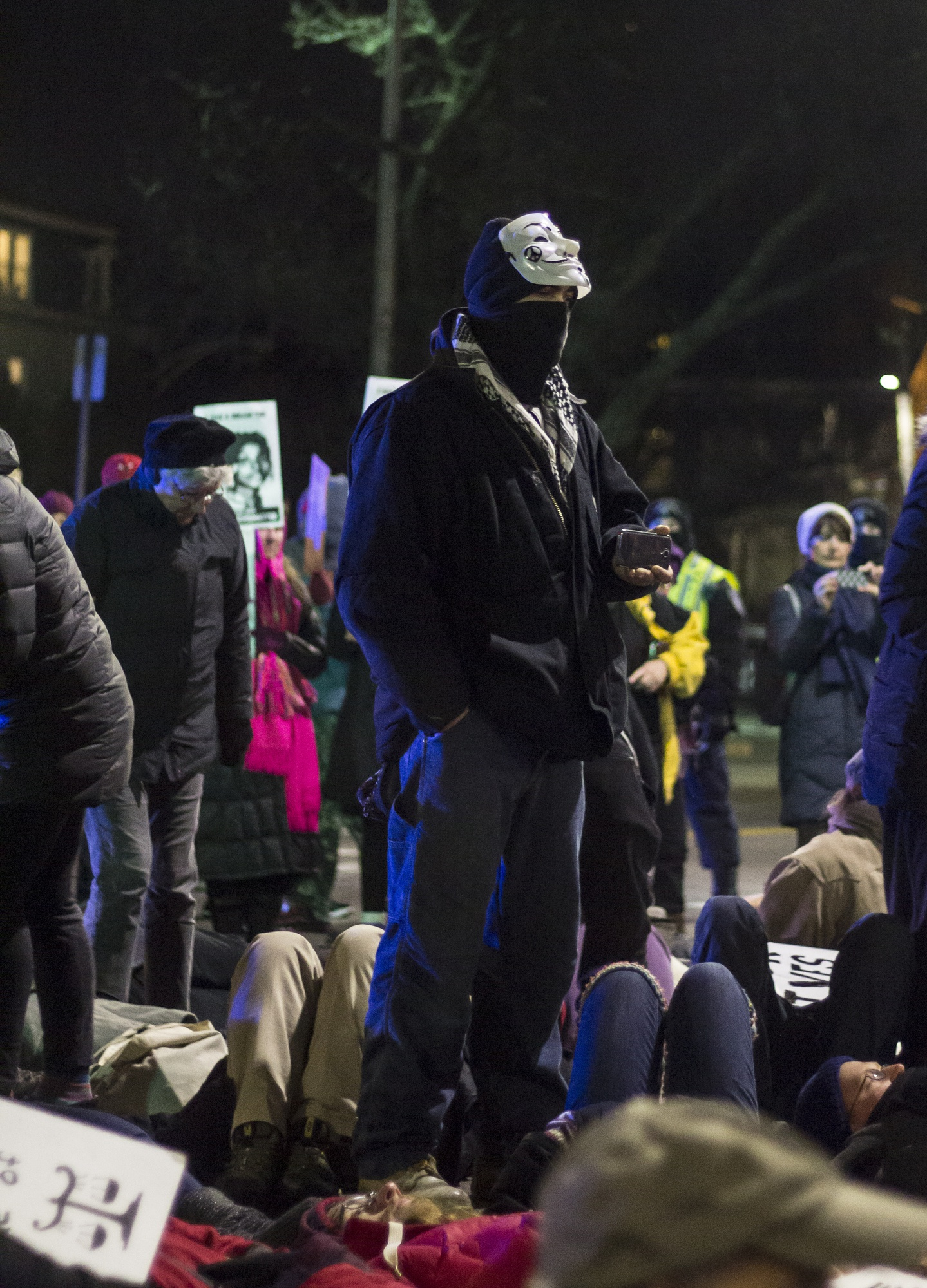 """A protester takes photos of the """"die-in"""" at the """"Black Lives Matter"""" protest in Cambridge on Wednesday evening."""