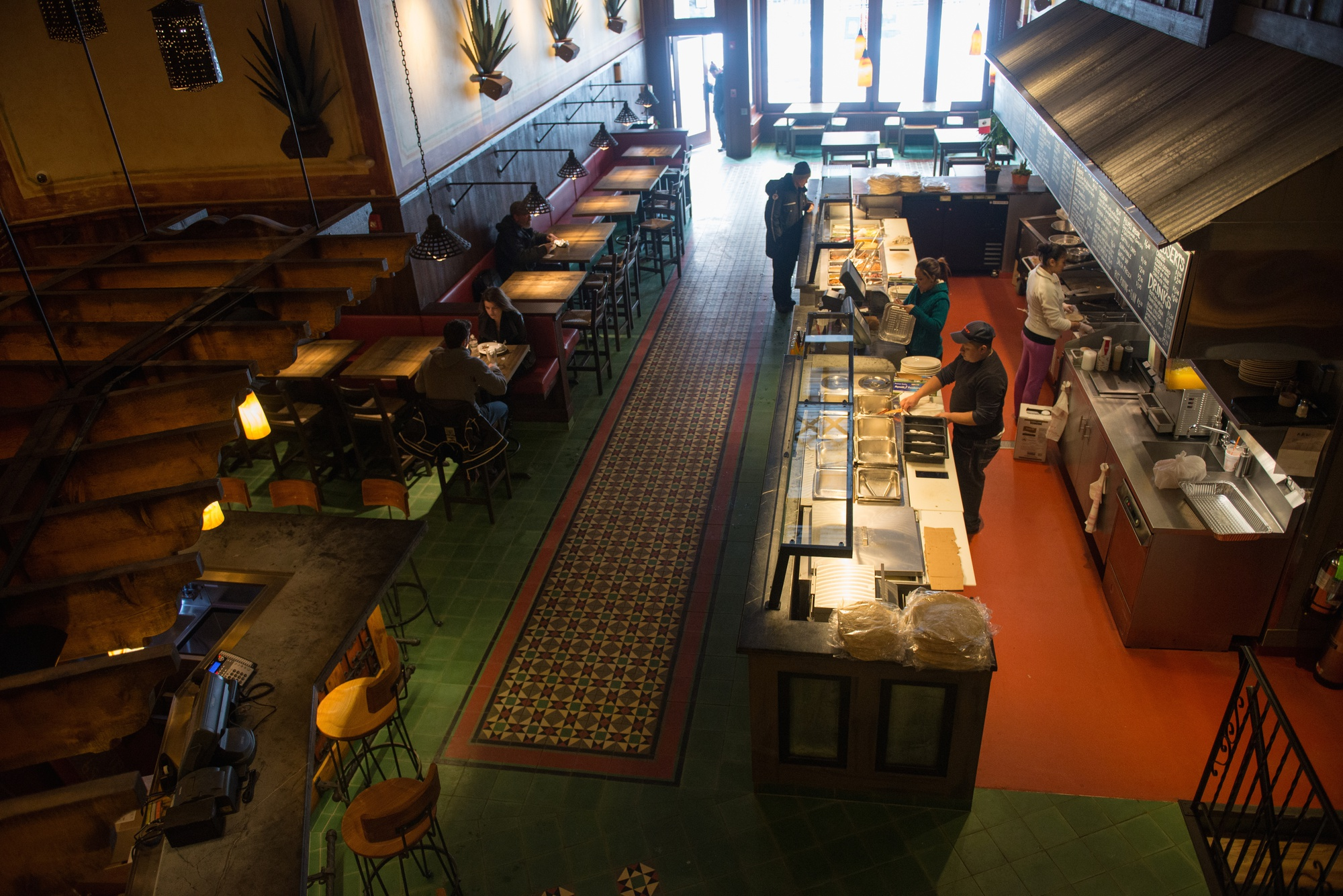 The new interior of Felipe's Taqueria features two levels of seating and a bar.