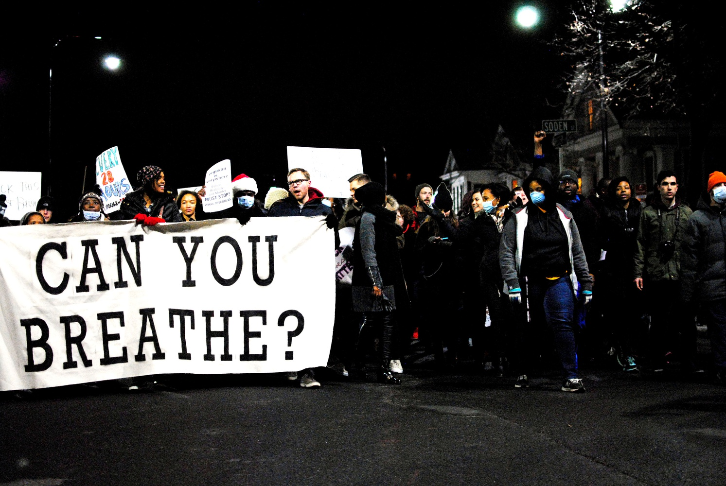"""Protesters marched up Western Avenue towards Central Square shouting """"We Can't Breathe"""" in December."""