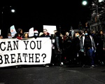 "Protests march up shouting ""We Can't Breathe"""