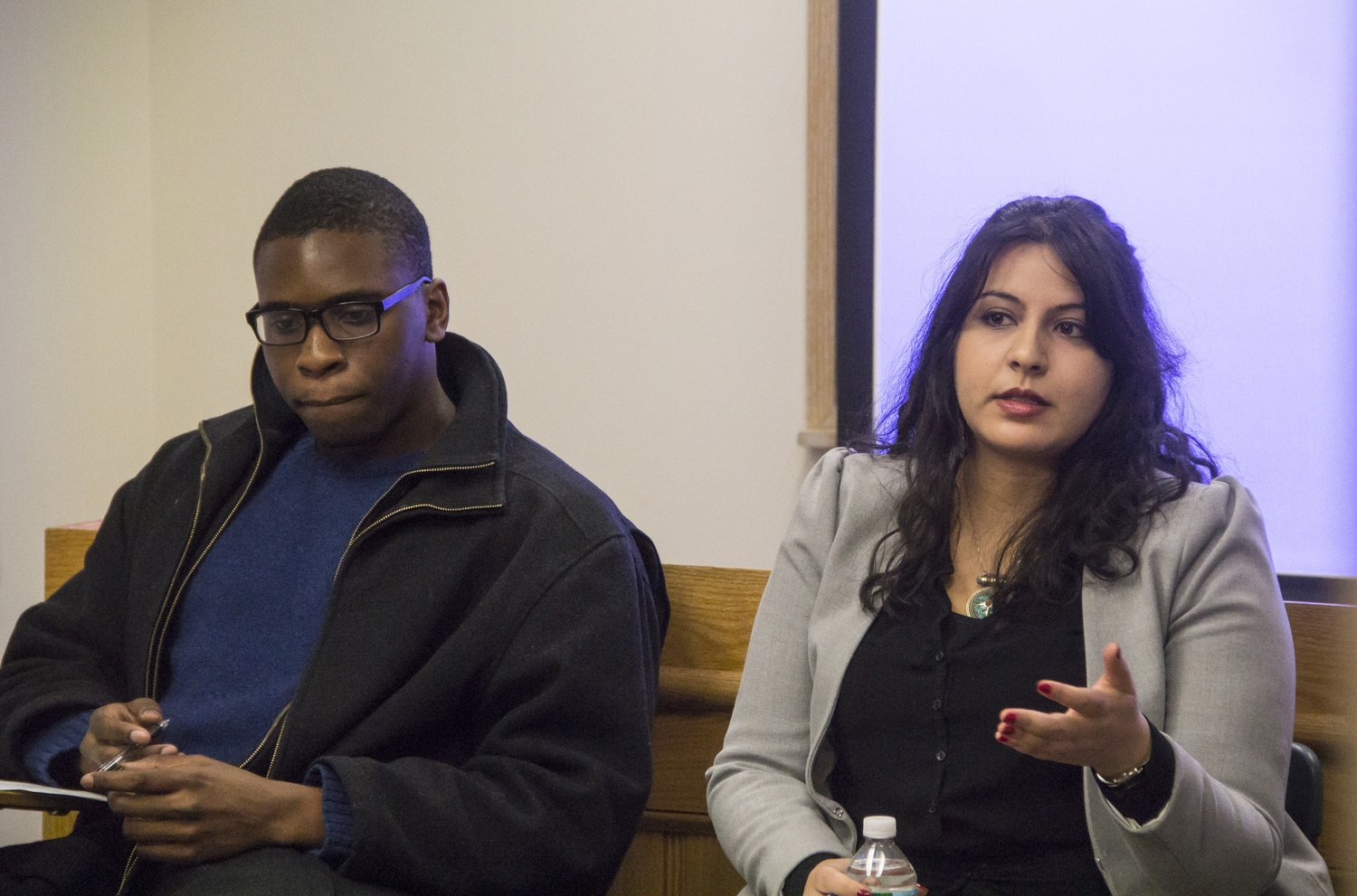 Temitope A. Agabalogun '15, left, and Nashwa Gewaily, a legal fellow at the Massachusetts ACLU, discuss the aftermath and consequences of the non-indictments of the police officers responsible for the deaths of Michael Brown and Eric Garner last year.