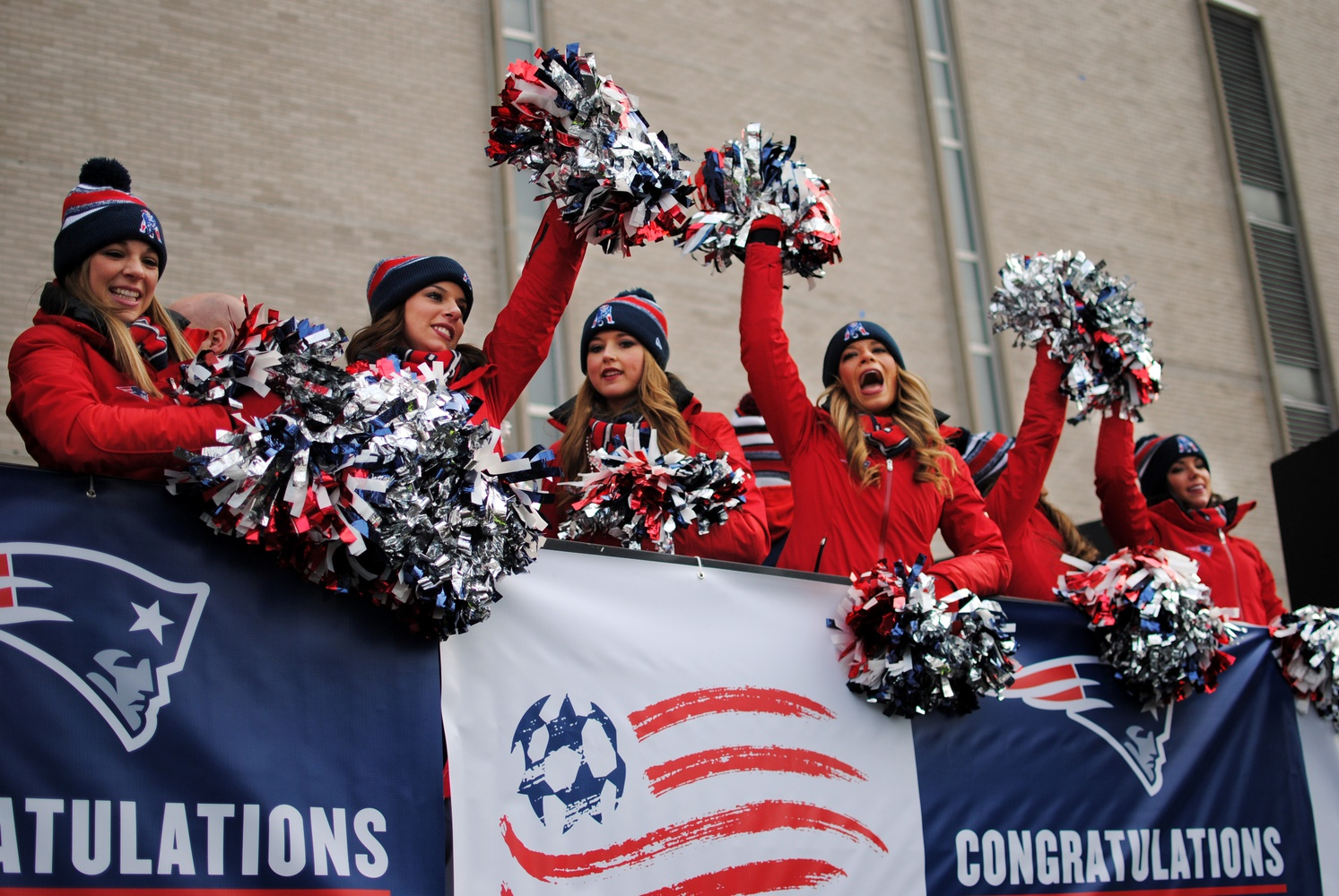 The Patriots cheerleaders celebrate the team's championship win during the Super Bowl parade outside Boston Commons on Wednesday.