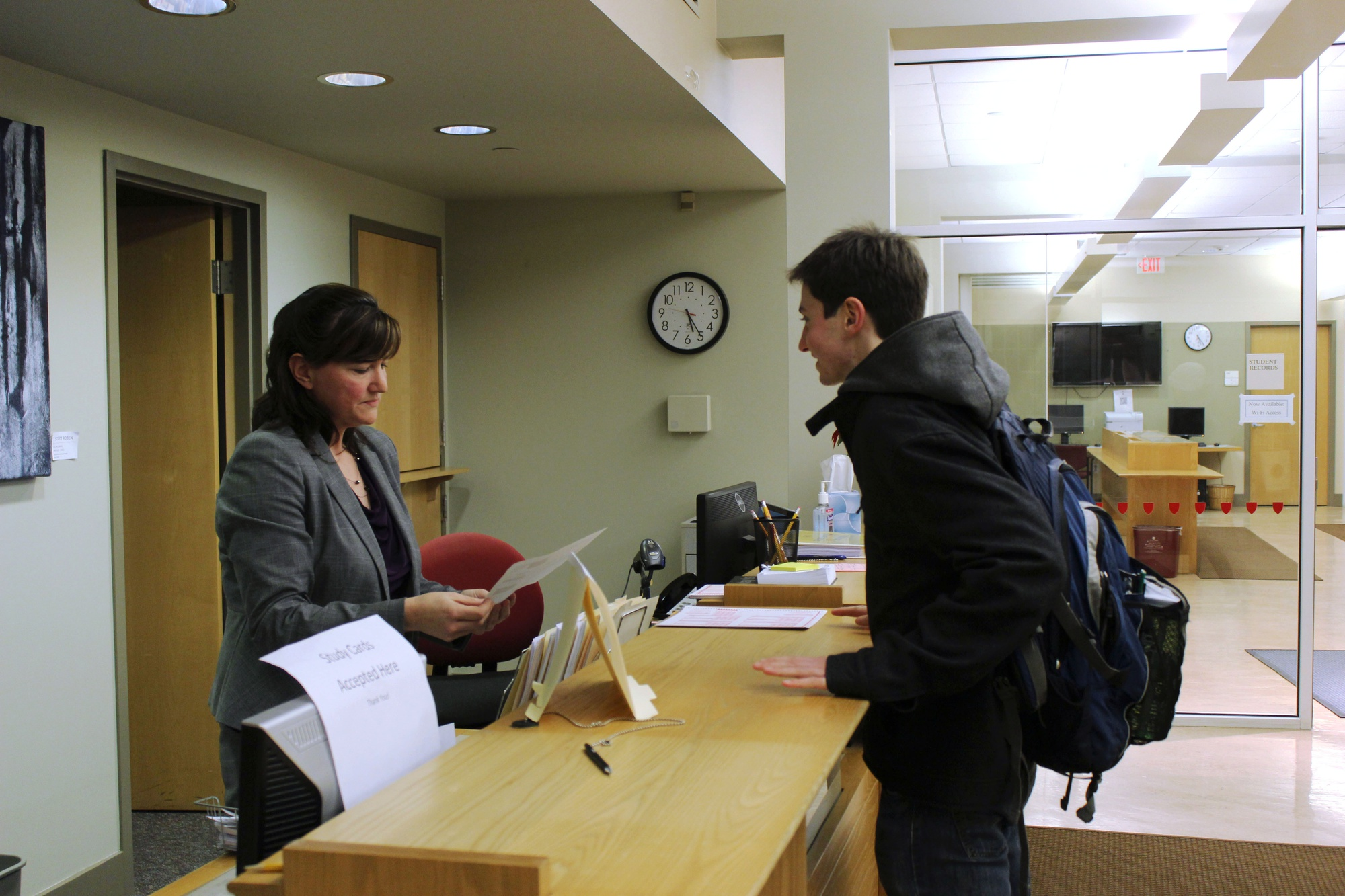 Associate Registrar for Enrollment Services Maggie Welsh reviews a study card at the Office of the Registrar Wednesday afternoon. Students took advantage of the fact that they would not be penalized with a late fee if they turned in their study cards late after a winter storm interrupted shopping week.