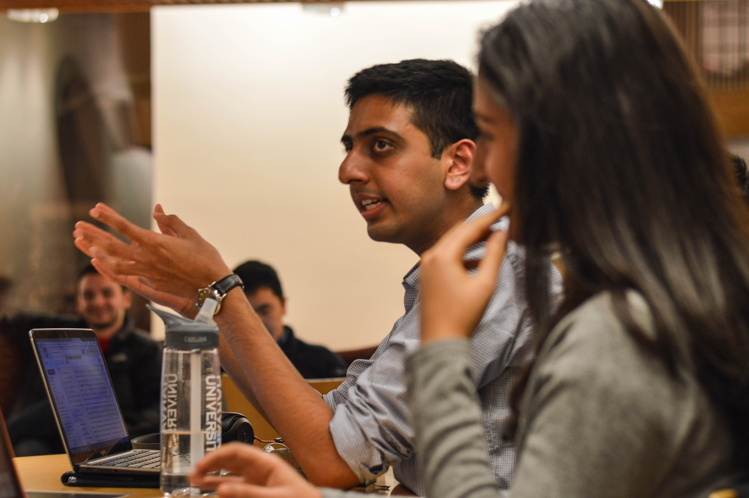 Undergraduate Council Vice President Dhruv P. Goyal '16 leads the Feb. 8 weekly UC meeting from the center of Ticknor Lounge alongside UC President Ava Nasrollahzadeh '16.  Topics discussed in the evening included outreach to potential UC candidates and a condom dispenser initiative.
