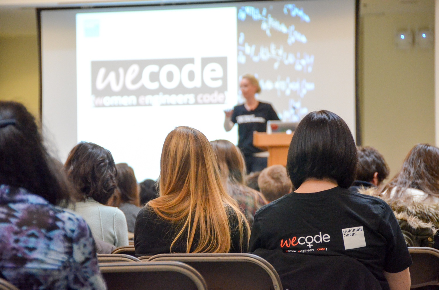 WECode conference attendees listen to a keynote address by Marie Louise Kirk on Saturday, Feb. 7.