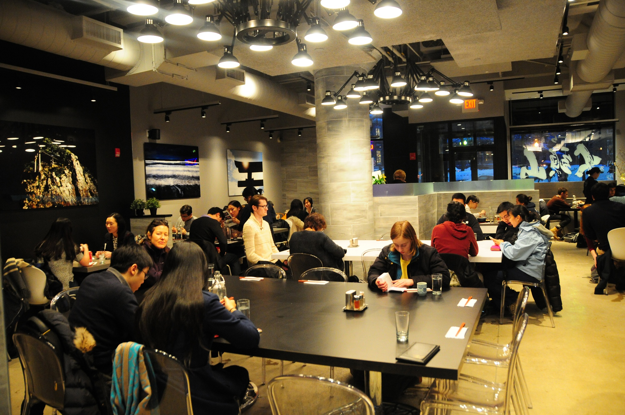 Customers enjoy freshly prepared ramen on a cold Tuesday evening. Santouka has experienced a rush of excited new customers who want to try out the newest eatery in Harvard Square.