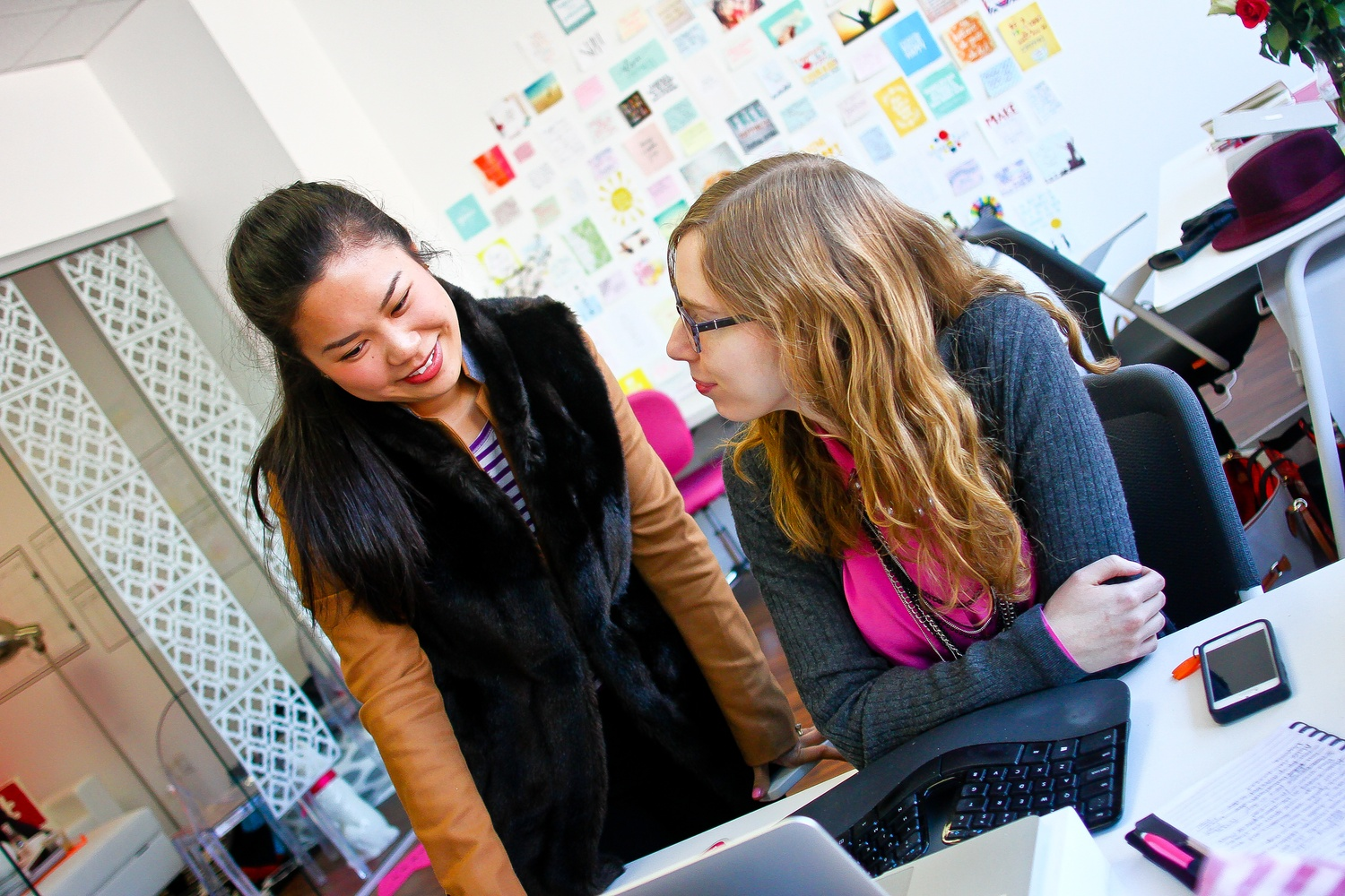 Annie Wang, co-founder of the online magazine Her Campus, touches base with the magazine's Product Manager Quinn Cohane.