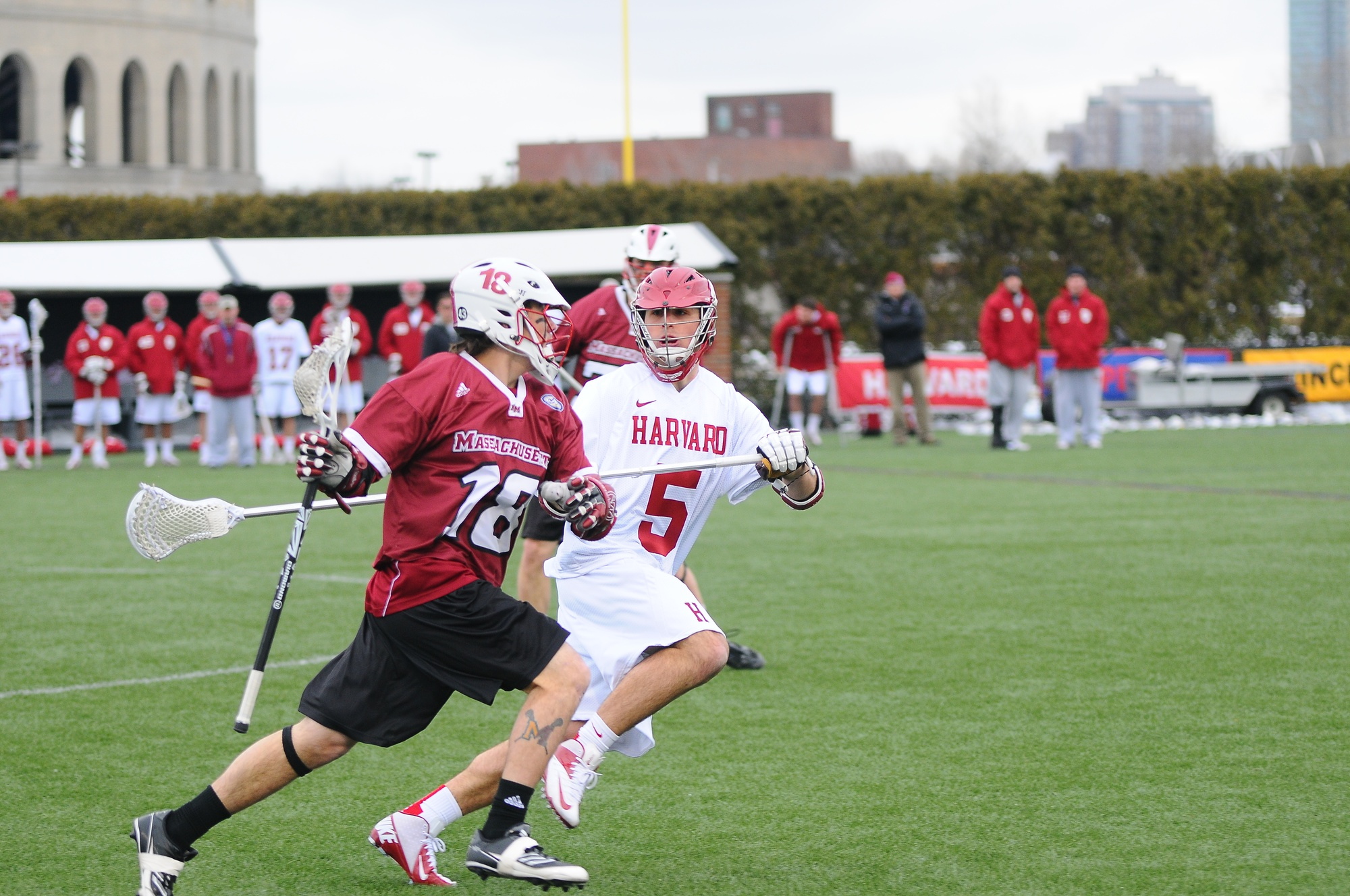 Junior Walker Kirby (5), shown here in earlier action, will contribute to a deep Crimson midfield this season as No. 13 Harvard tries to replace key graduated players at the position. Last season, the Crimson won its first Ivy League Championship in 24 years, sharing the regular season crown with Cornell.