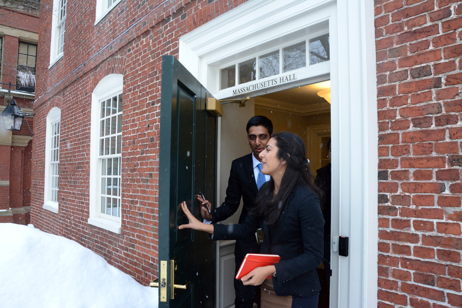 Undergraduate Council President Ava Nasrollahzadeh '16 and Vice President Dhruv P. Goyal '16 leave University President Drew G. Faust's office after meeting with her in Massachusetts Hall on Feb. 18