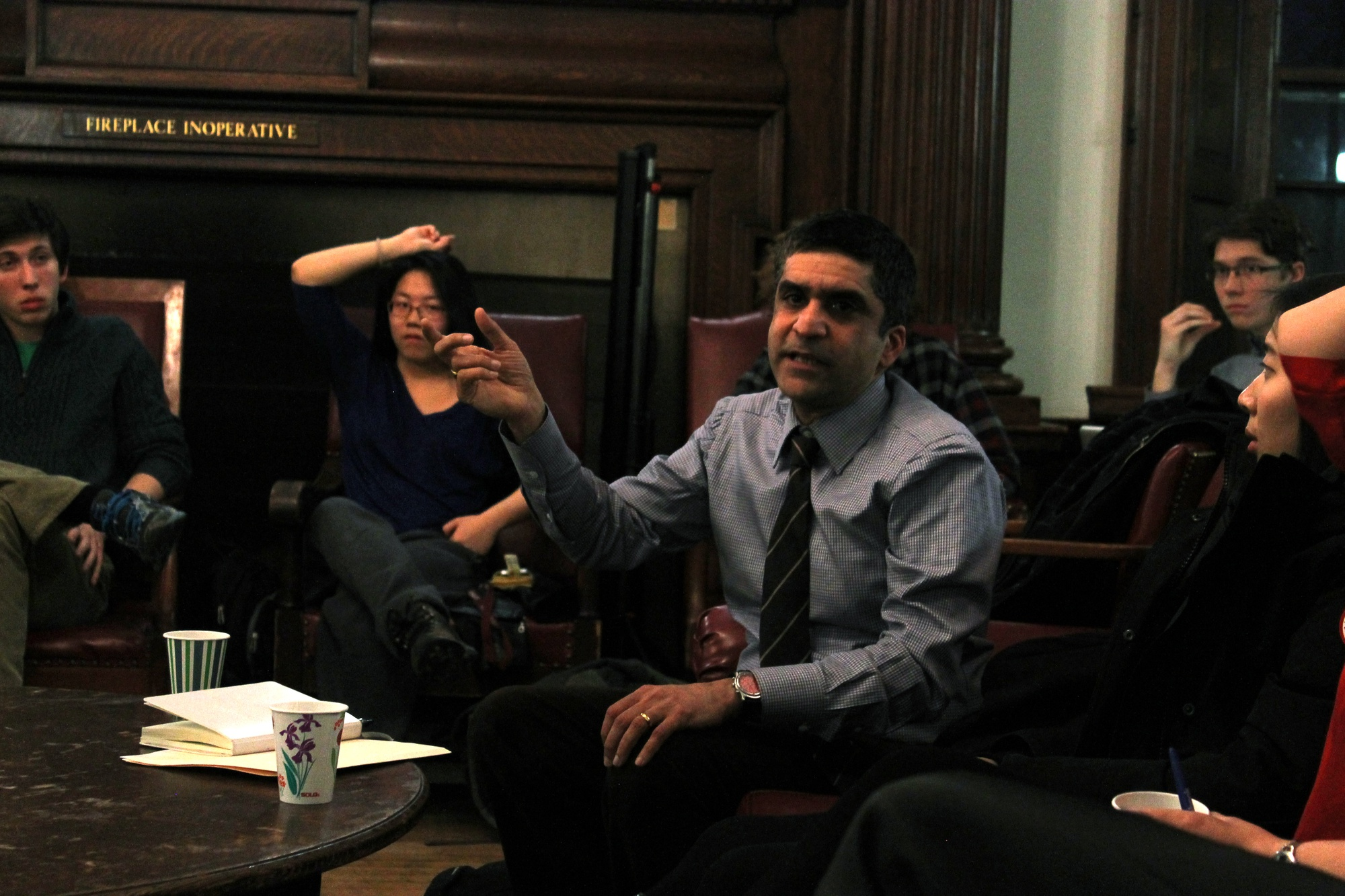 Dean of the College Rakesh Khurana leads a discussion with students about balancing academics and extracurriculars at a town hall in the Phillips Brooks House Parlor on Wednesday evening.