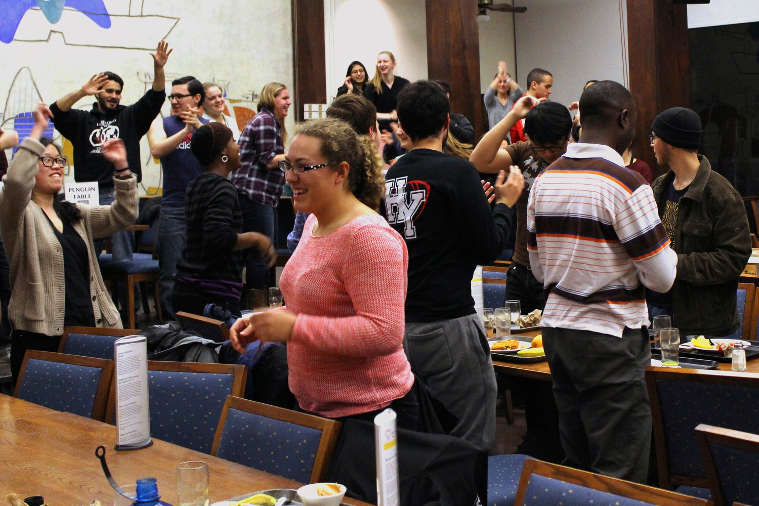 Singing and dancing in their dining hall, students in Quincy House produce their Housing Day video in 2015.