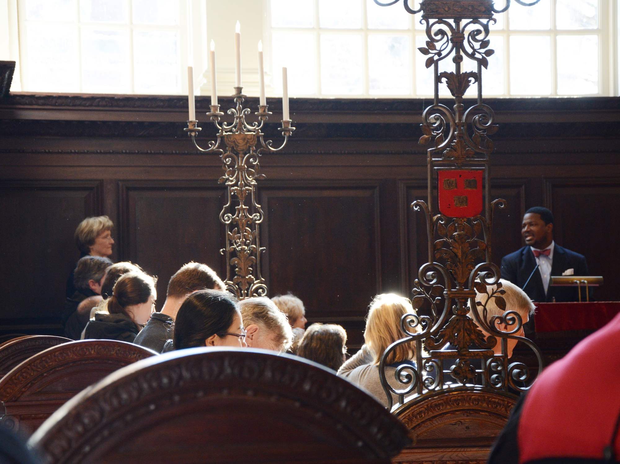 President Drew G. Faust looks on as Pusey Minister in Memorial Church Jonathan L. Walton speaks. On Friday morning, Faust gave a speech during the morning prayers service reflecting on the time when she skipped her midterms as a college freshman to attend the voting rights march at Selma.