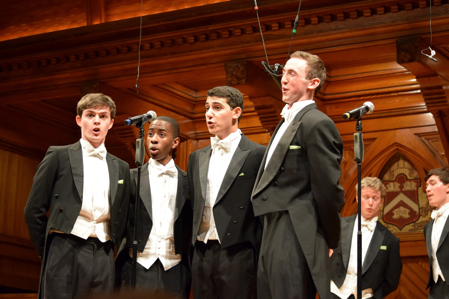 Matthew T. Barber '16, Sydney T. S. Mukasa '18, Jacques Berguig, and Will Jaroszewicz '17 of the Din & Tonics sing in a 2015 performance in Sanders Theatre.