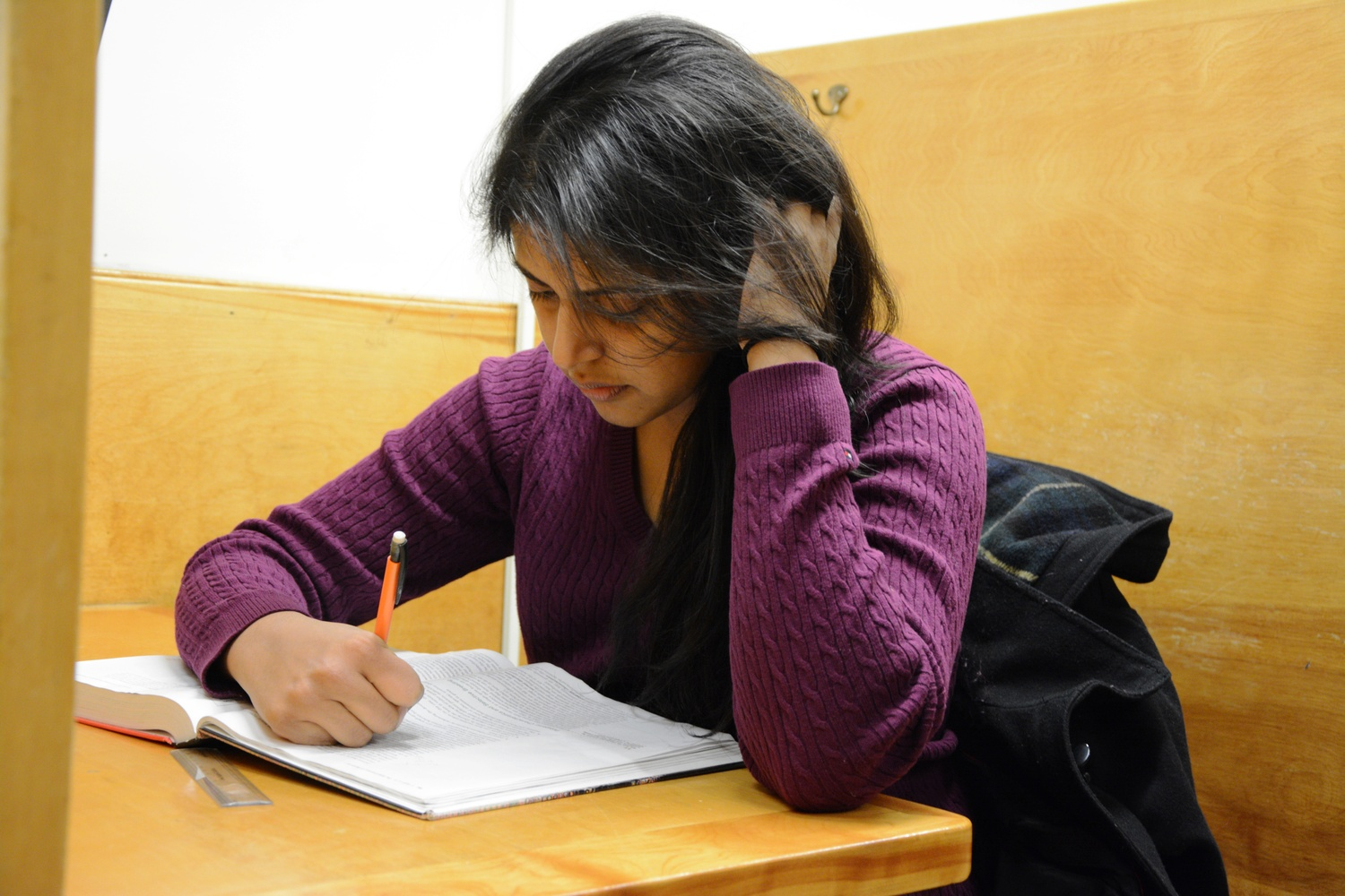 Varsha Varman '18 studies for her SLS 20 exam in the basement of Lamont Library on Saturday afternoon.