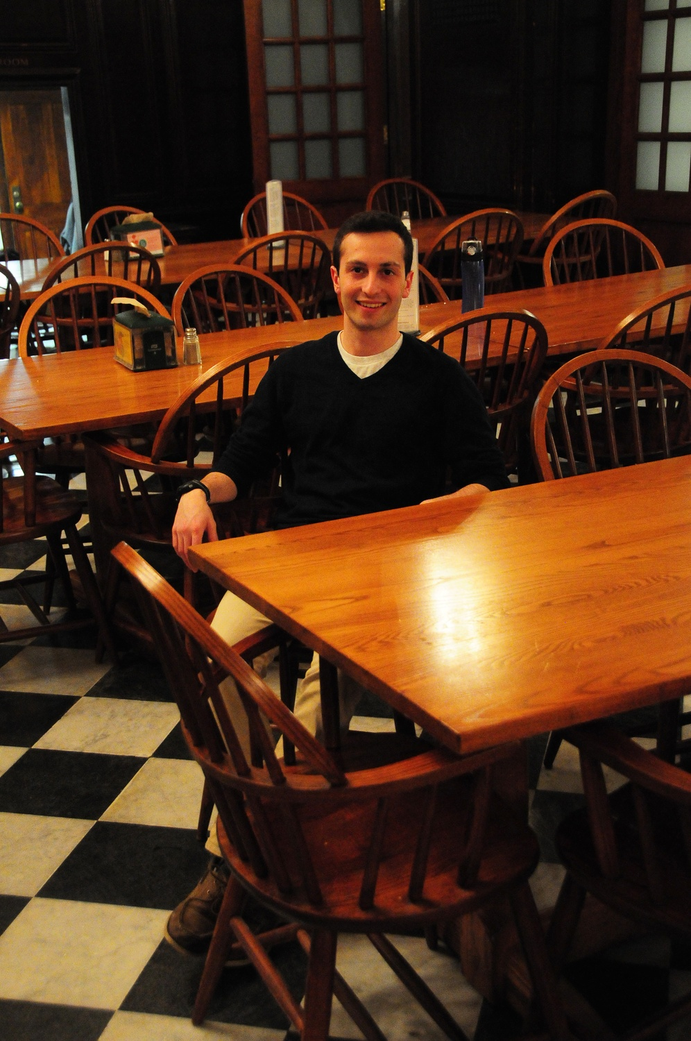 Jacob R. Carrel '16, president of the Harvard College Democrats, relaxes in Winthrop House dining hall on Monday night. Carrel is one of many students trying to balance House life and extracurricular obligations.