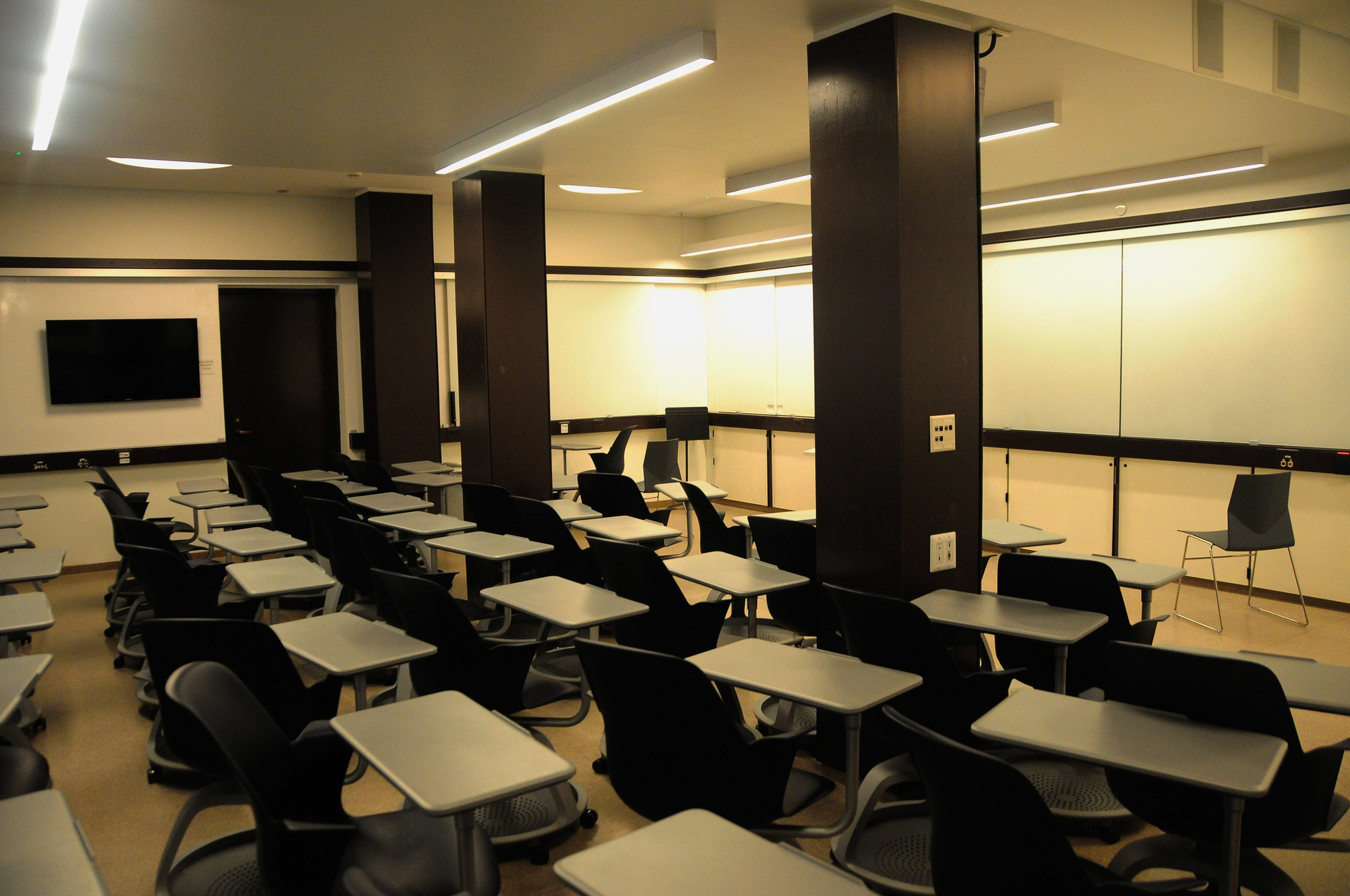 """The """"smart classroom"""" in Stone Hall of Quincy House contains improved technology, including touch-sensitive tablets and cameras. Renovations at Quincy House are a part of Harvard's attempt to foster learning communities throughout the houses in an era of rapid technological advancement."""