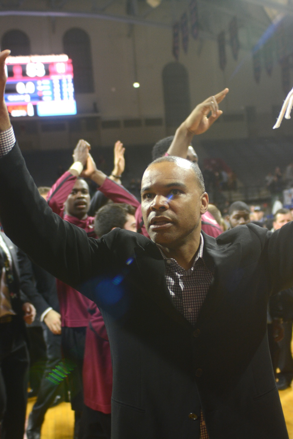 Harvard coach Tommy Amaker and his Crimson team earned their fourth-consecutive NCAA Tournament berth after beating Yale on a last-minute basket from co-captain Steve Moundou-Missi.