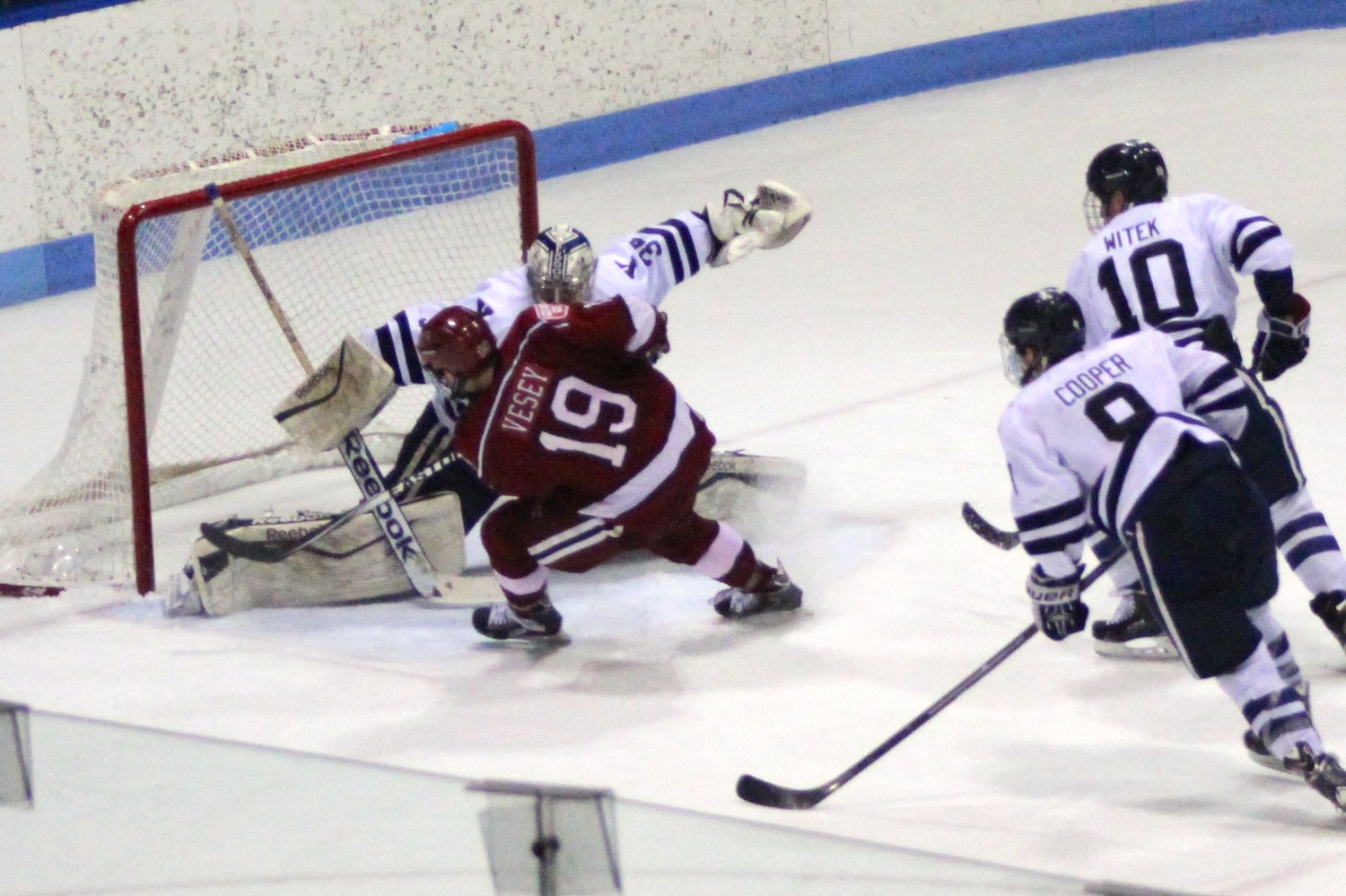 Junior forward Jimmy Vesey beat Yale goaltender Alex Lyon in the second overtime period to send the Crimson into the ECAC tournament semifinals.