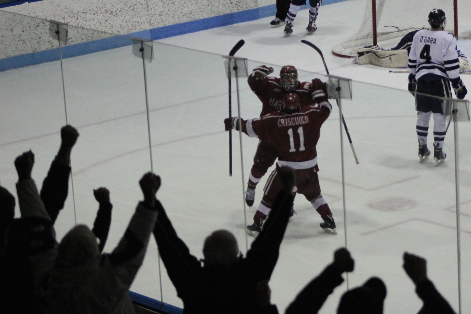 Vesey celebrates with junior co-captain Kyle Criscuolo. Harvard will play in the ECAC tournament's final weekend for the first time since 2012.