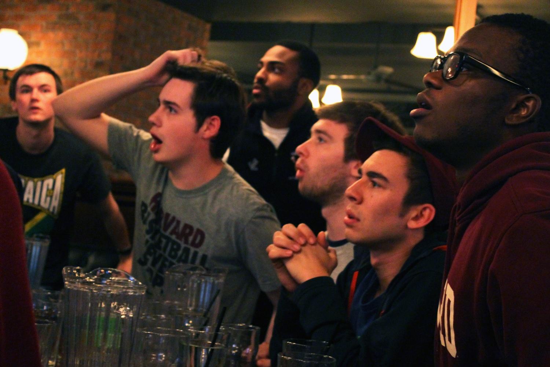 Harvard basketball fans watch the final moments of the Harvard vs. UNC game on Thursday at John Harvard's.