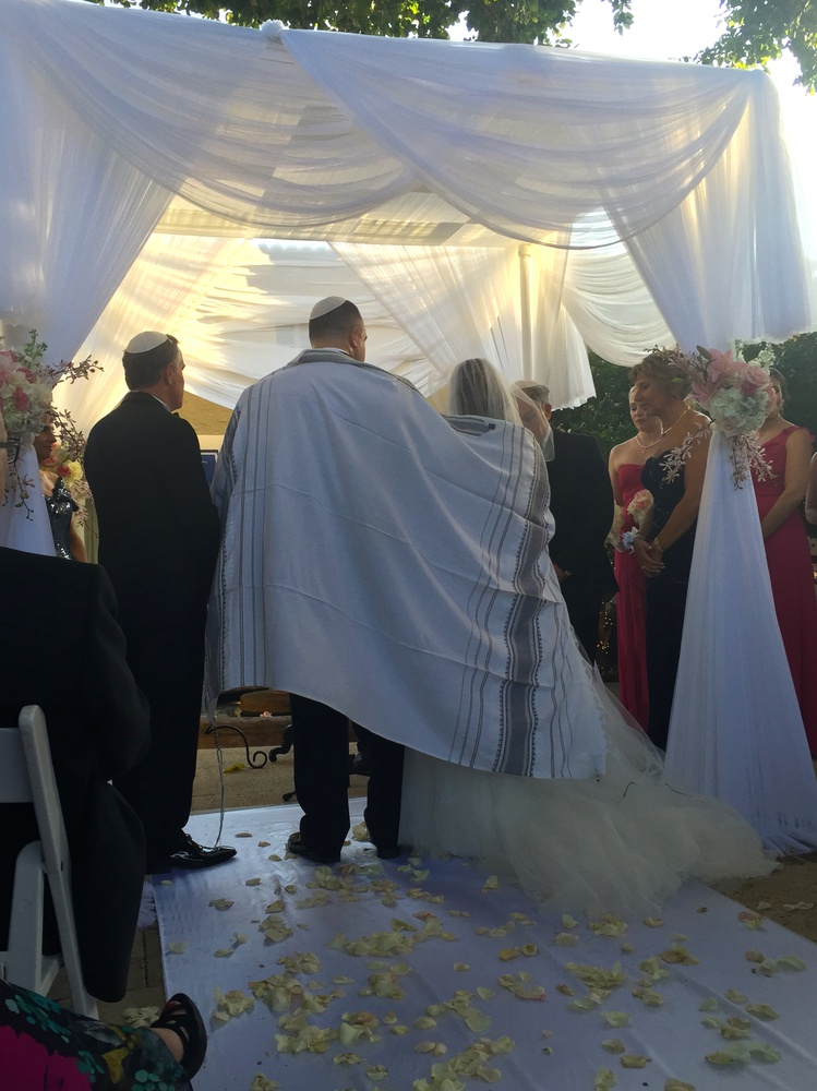 I started off my spring break with my cousin's wedding. My cousin Josh Grossman is standing under the chuppah, a traditional covering in Jewish weddings, with his new wife, Tami.