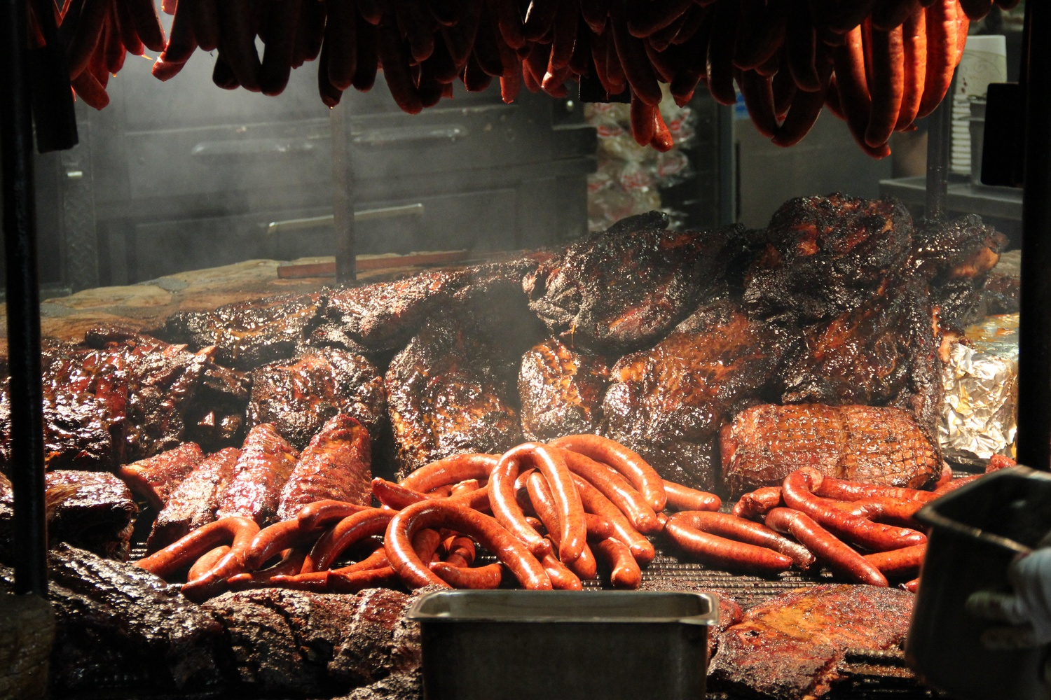 During spring break I visited The Salt Lick, a popular barbecue restaurant in Driftwood, Texas. Inside is a wood-fired pit where meat is kept warm after a long smoking process.