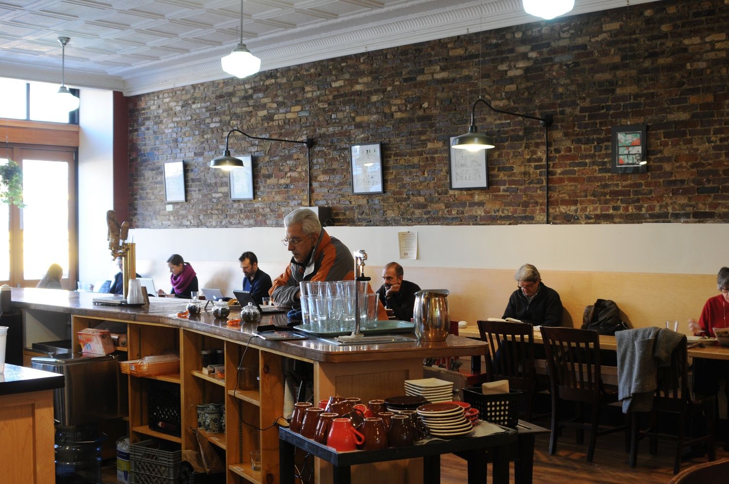 On a Thursday afternoon, many people sit, relax, and enjoy their coffee in Dwelltime's space.