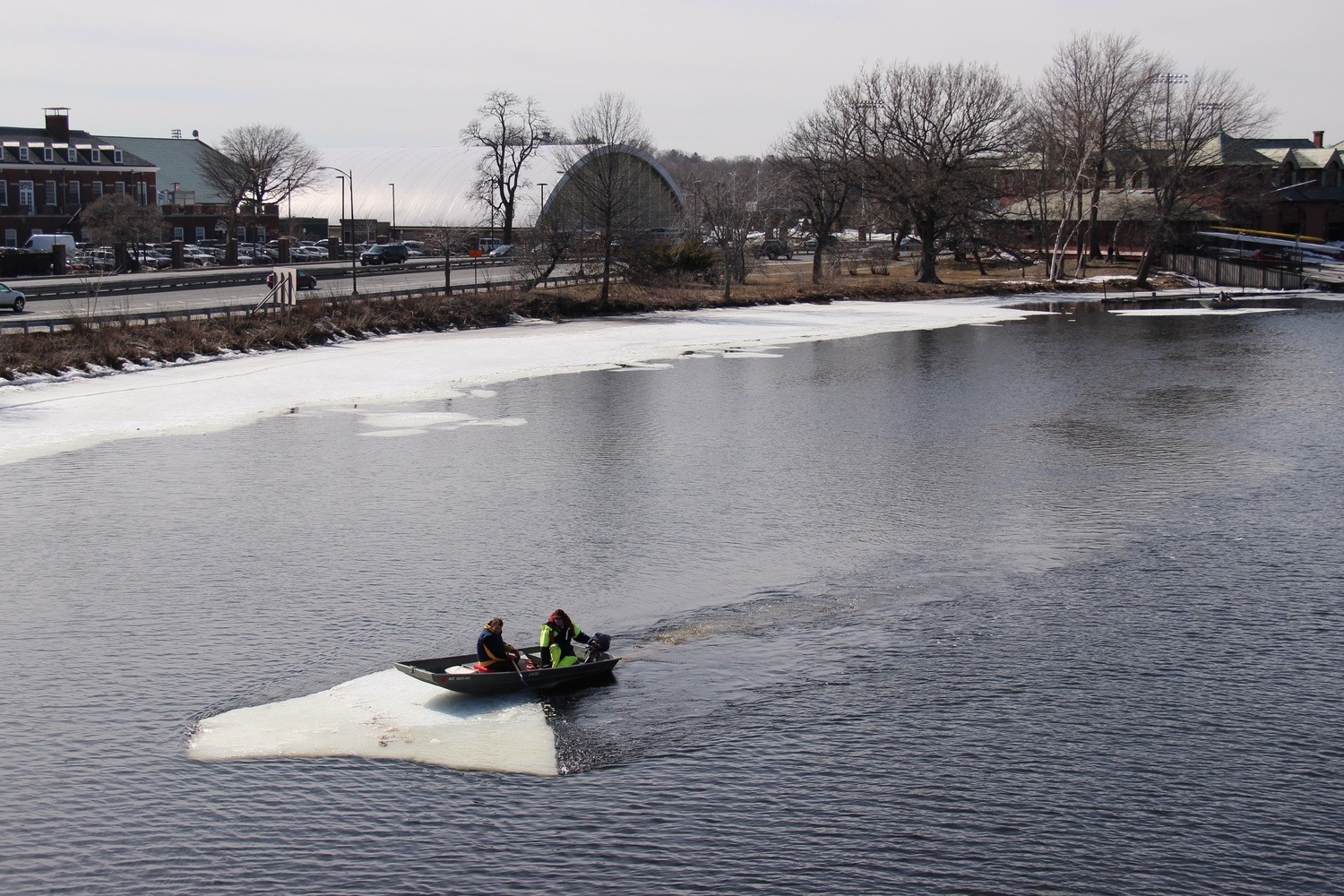 Coaches William Boyce and Hugo Gulliver clear residual ice from the Charles river Wednesday afternoon. The ice has limited dock access and rowing area in recent weeks, according to Lightweight Head Coach Michiel Bartman.