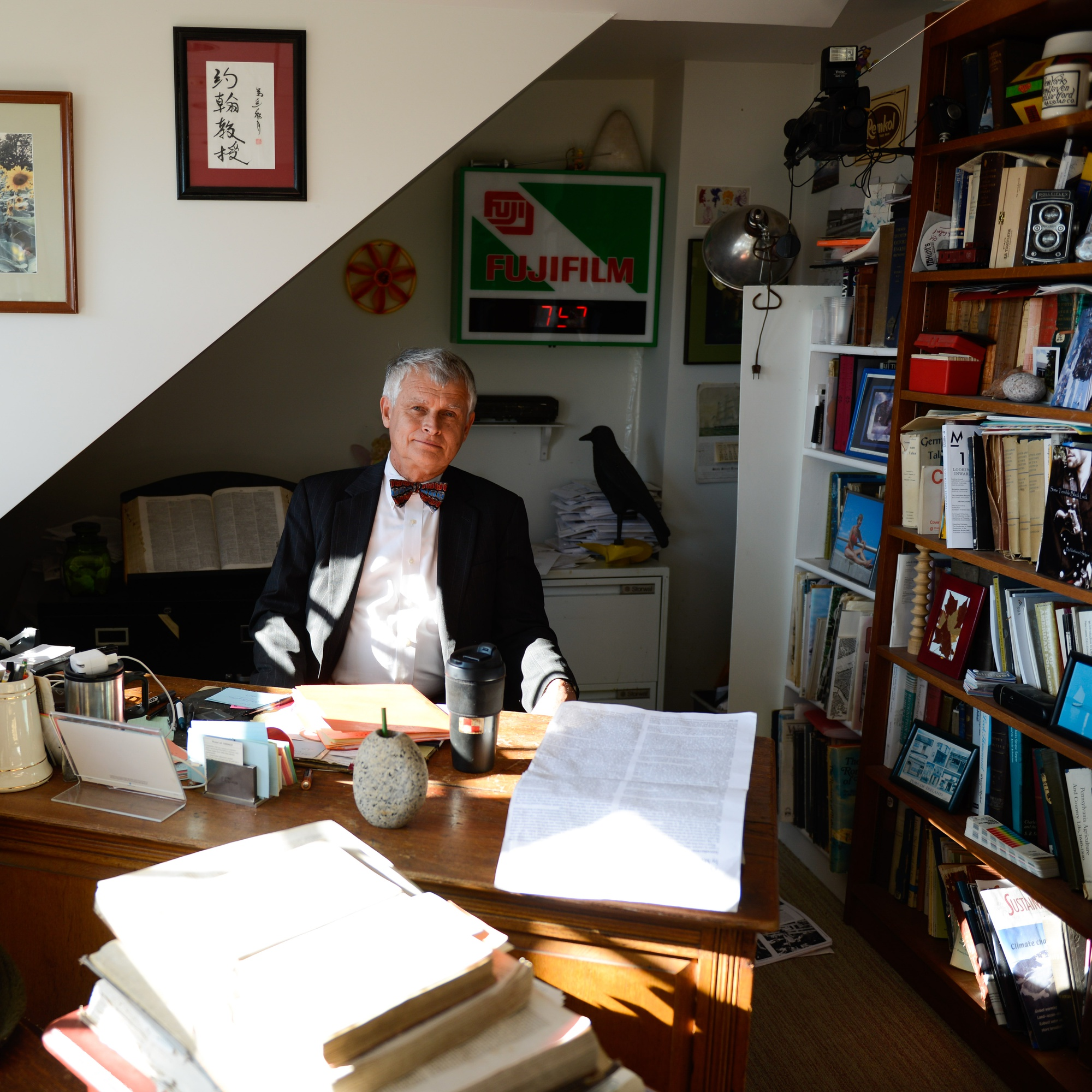 Stilgoe poses in his office on the top floor of Sever Hall. Students frequently drop by for office hours.