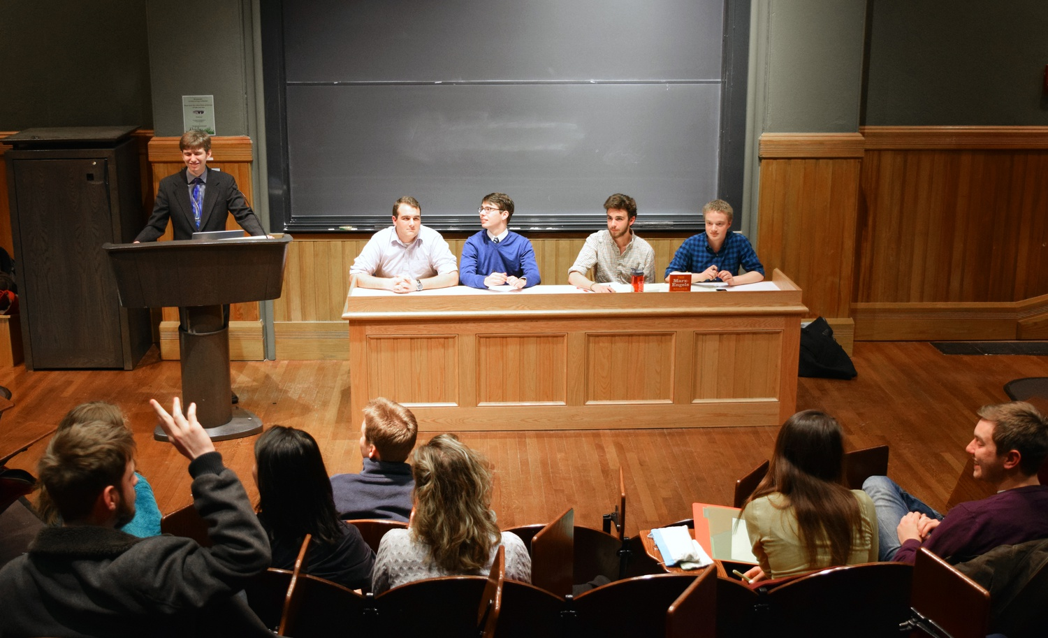 """Students sit on a panel during an undergraduate debated entitled, """"Is Capitalism Good?"""" The Harvard Political Union hosted the event in Sever Hall Wednesday evening."""