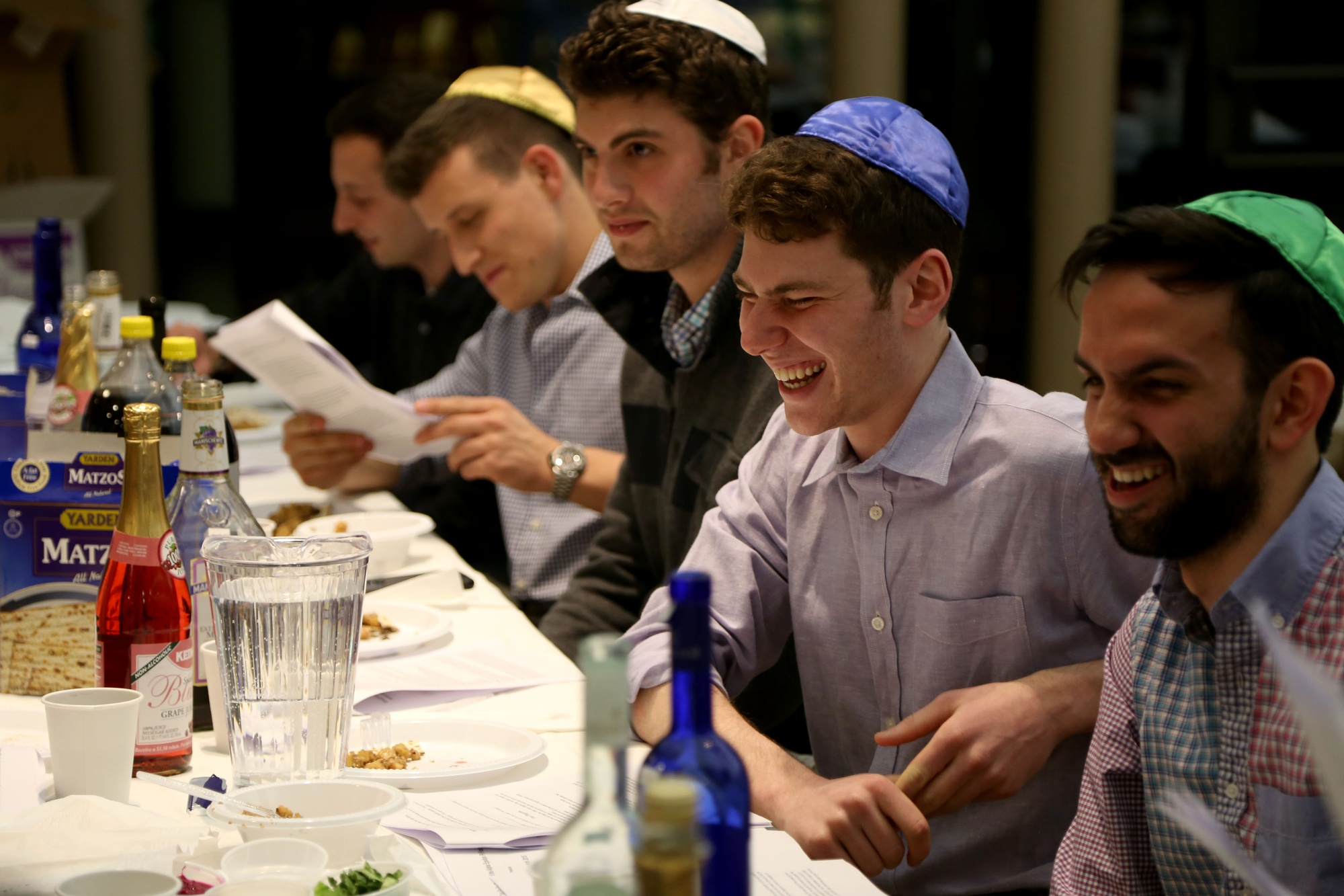 From right, Alpha Epsilon Pi brothers Aaron E. Pelz '16, Crimson editor Gregory A. Briker '17, Ethan S. H. Fried '16, and Jacob S. Goldberg '16 celebrate Passover during a seder, a traditional Jewish ritual, in Hillel on Saturday evening.