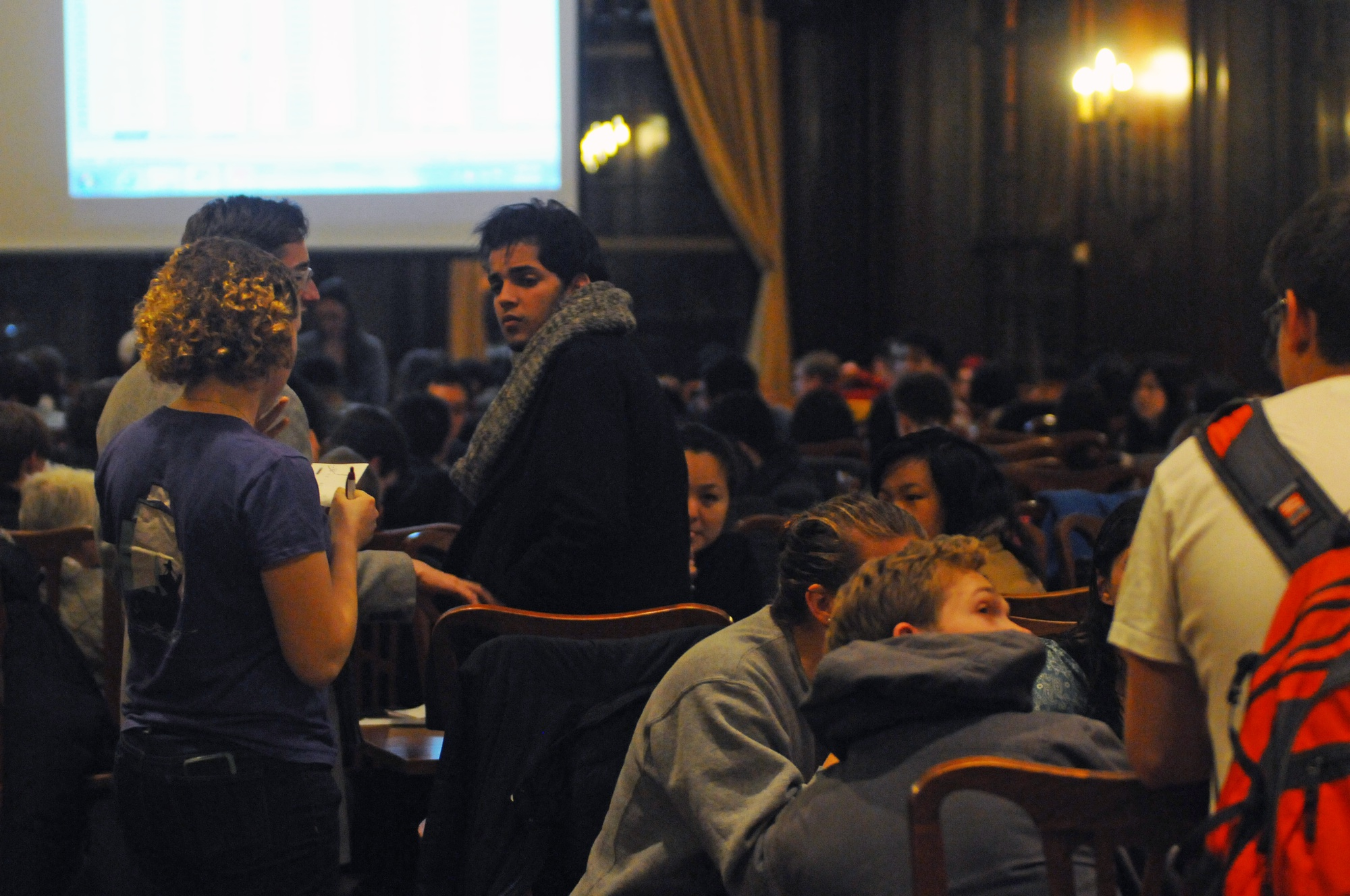 Students gather in Adams dining hall in anticipation of room assignments from the housing lottery. Many housing lotteries have taken place this week.