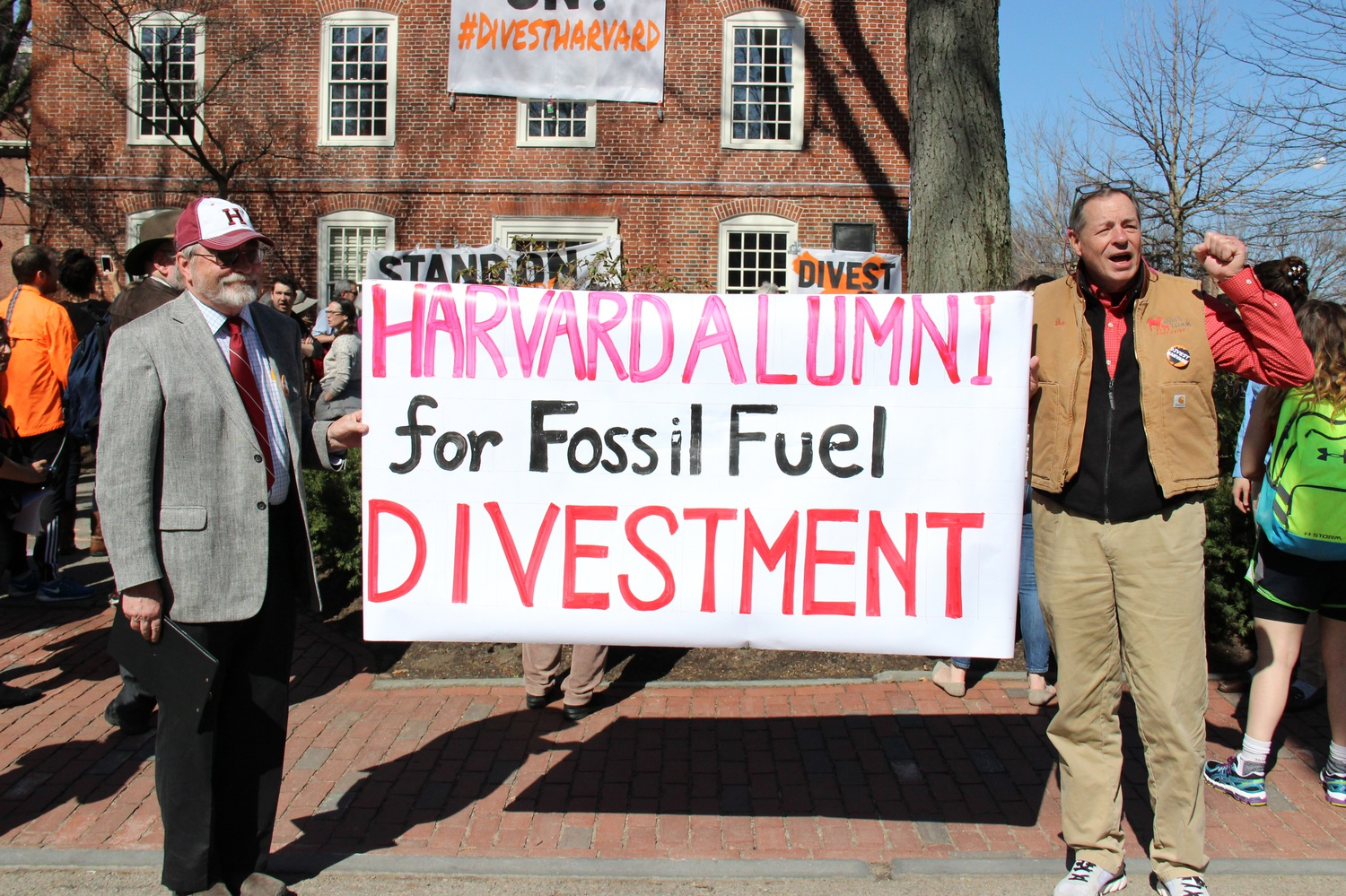 """Donald M. Hooper '68 and C. """"Al"""" Boright '68, President of the Harvard-Radcliffe Club of Vermont, hold a banner calling for University divestment from fossil fuels. Hooper and Boright took part in a rally held Monday morning as part of """"Harvard Heat Week."""""""