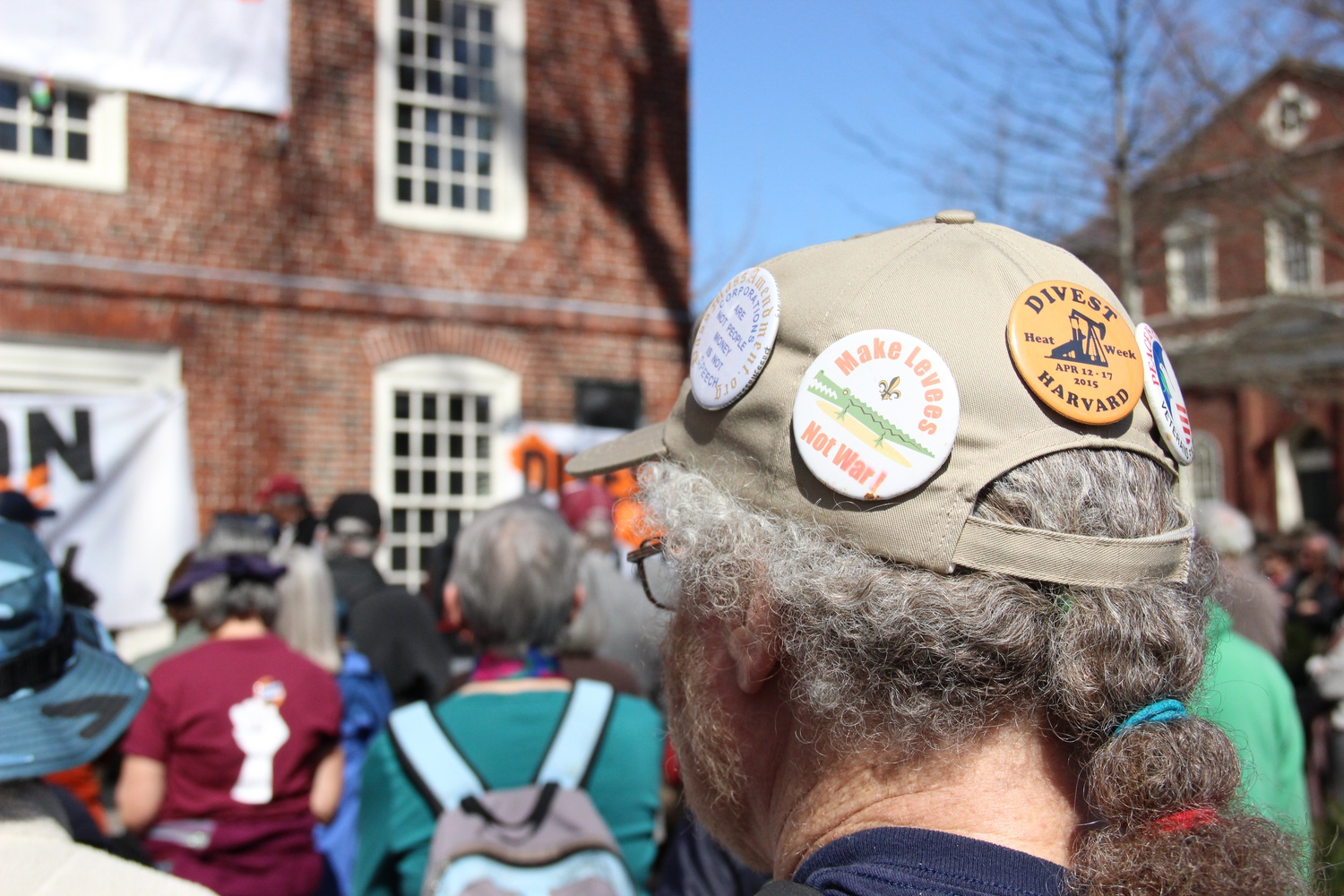 """A protester attends a rally held Monday morning as part of """"Harvard Heat Week."""""""