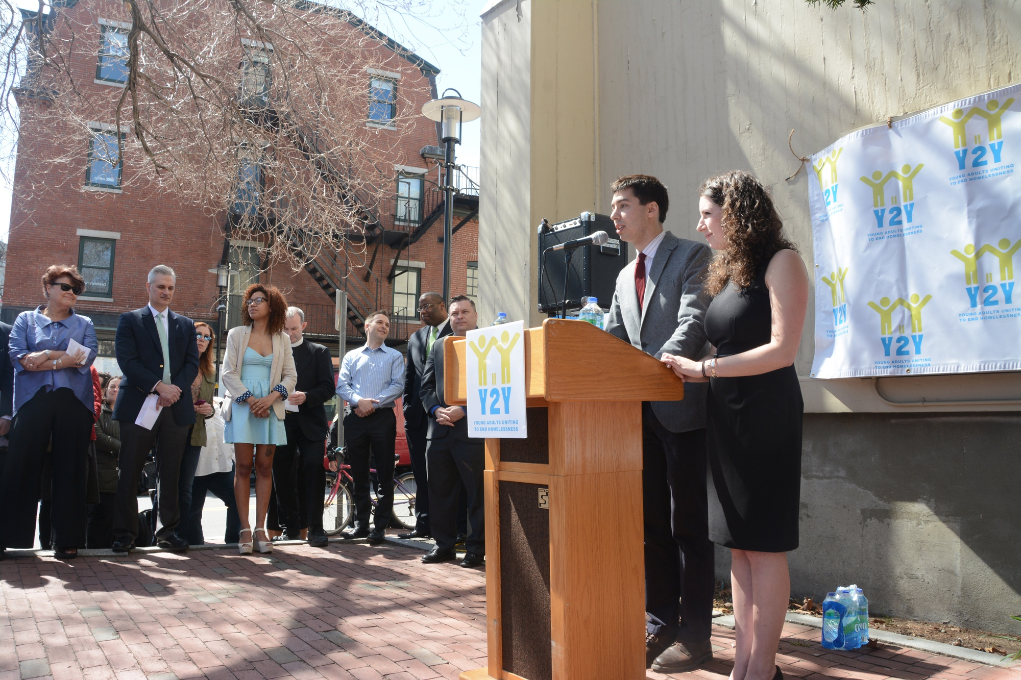 Samuel G. Greenberg '14 and Sarah A. Rosenkrantz '14, speak at the Y2Y youth homeless shelter launch event outside First Parish in Cambridge Monday. The shelter is set to open this November.